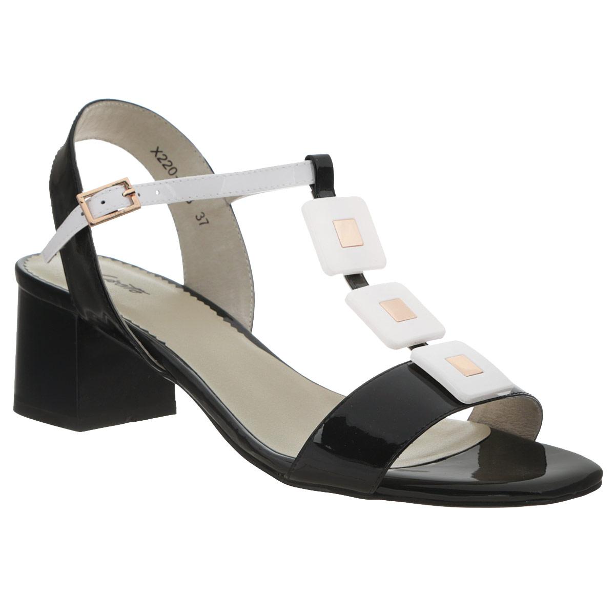 Босоножки женские. X220-01BX220-01BСтильные босоножки на каблуке от Lisette станут прекрасным дополнением летнего гардероба. Верх модели выполнен из натуральной лакированной кожи. Внутренняя часть и стелька также выполнены из натуральной кожи. Босоножки с открытым носком и пяткой надежно фиксирует на ноге ремешок с металлической пряжкой. Союзка оформлена декоративными элементами контрастного цвета. Устойчивый широкий каблук обеспечит комфорт при ходьбе. Подошва выполнена из прочной резины с нескользящим рифлением. Такие босоножки сделают вас ярче и подчеркнут вашу индивидуальность.