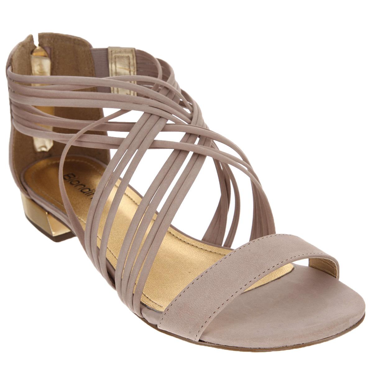 Сандалии женские. 63976397-1Эффектные женские сандалии от Biondini не оставят равнодушной настоящую модницу. Модель изготовлена из высококачественной натуральной кожи. Сандалии дополнены полужестким кожаным задником с застежкой-молнией. Фиксирующие ремешки надежно закрепят модель на ноге. Стелька из натуральной кожи с названием бренда и прострочкой по контуру комфортна при ходьбе. Низкий каблук декорирован вставкой, стилизованной под металл. Подошва с рифлением обеспечивает идеальное сцепление с любой поверхностью. Стильные сандалии помогут вам создать яркий запоминающийся образ.