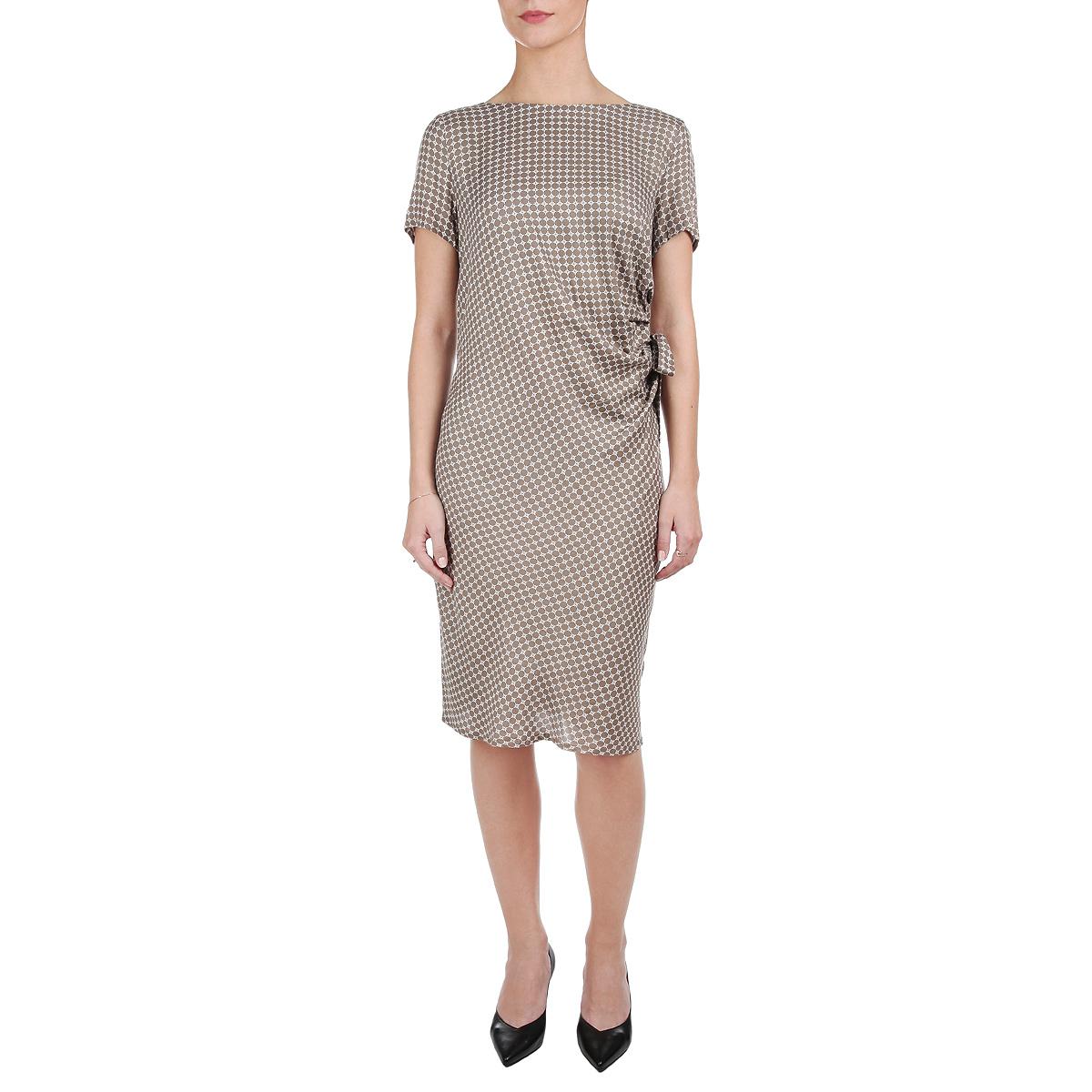 Платье. S15-11036S15-11036_602Элегантное платье Finn Flare, выполненное из мягкой вискозы, создаст утонченный образ. Платье с круглым вырезом горловины и короткими рукавами, сбоку на талии слегка присборено и оформлено бантом. На спинке изделие застегивается на потайную молнию. Облегающий силуэт и актуальная длина выгодно подчеркнут все достоинства вашей фигуры. Эффектное платье станет замечательным дополнением к вашему летнему гардеробу.