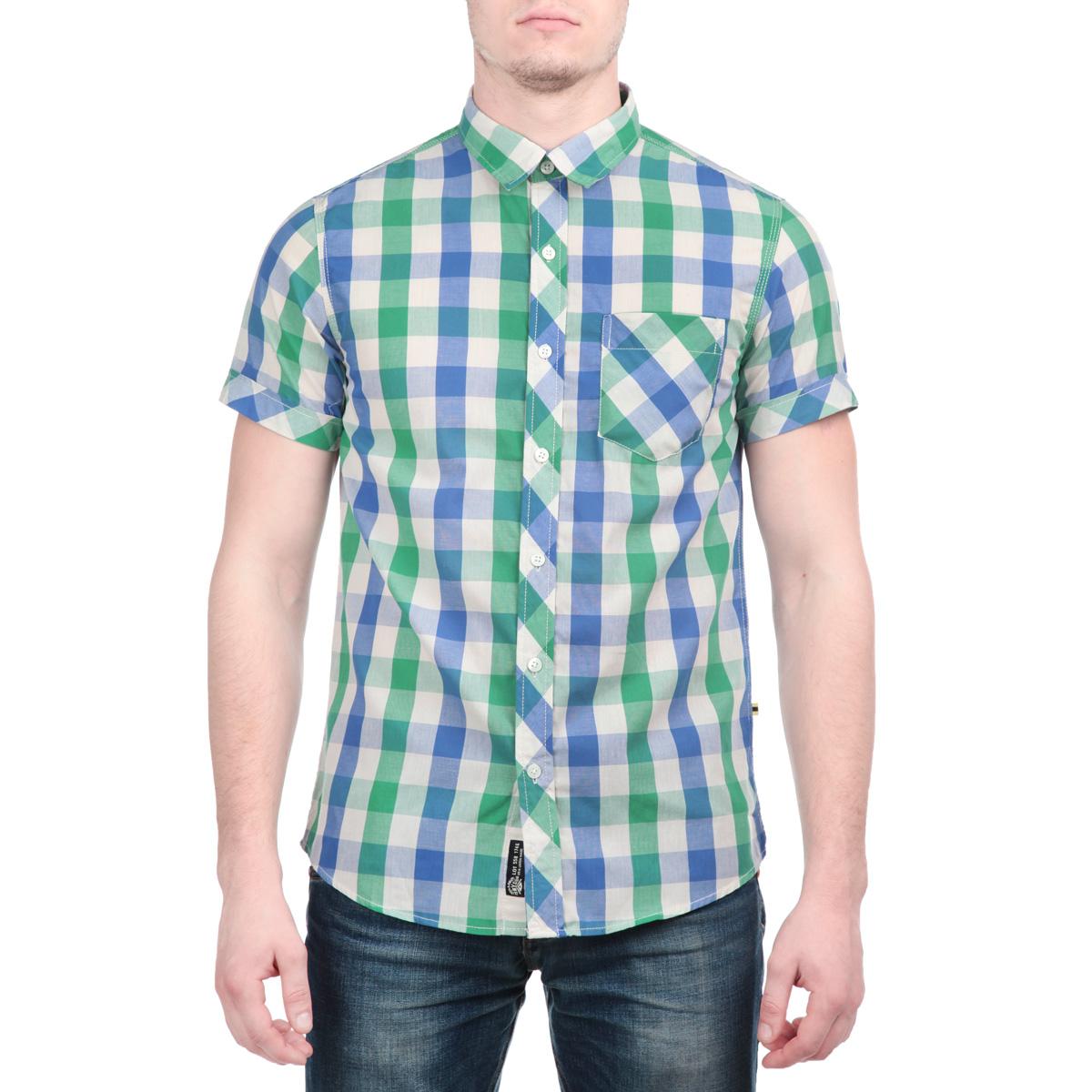 Рубашка мужская. 1015255110152551 00LМужская рубашка Broadway, выполненная из высококачественного хлопка с добавлением полиэстера, обладает высокой теплопроводностью, воздухопроницаемостью и гигроскопичностью, позволяет коже дышать, тем самым обеспечивая наибольший комфорт при носке. Рубашка прямого кроя с короткими рукавами и отложным воротником застегивается на пуговицы, и оформлена актуальным принтом в клетку. Модель дополнена накладным нагрудным карманом. Такая рубашка подчеркнет ваш вкус и поможет создать великолепный современный образ.