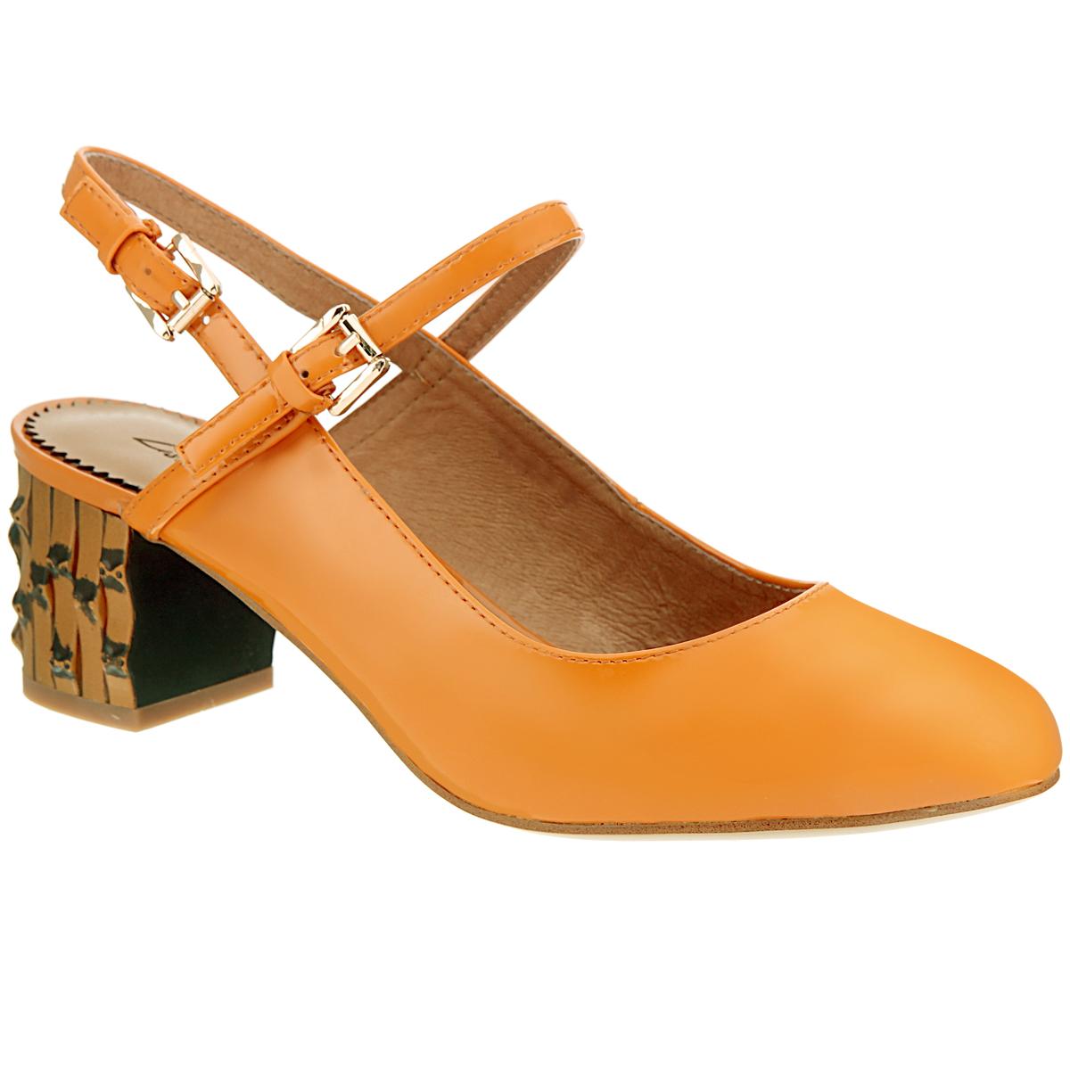 Туфли женские. 6021-10-36021-10-3Женские туфли на каблуке от Lisette прекрасно подчеркнут ваш стиль. Верх модели выполнен из натуральной лакированной кожи. Стелька из натуральной кожи гарантирует комфорт и удобство при ходьбе. Пятка открытая. Два тонких ремешка с металлическими пряжками вокруг щиколотки надежно фиксируют модель на ноге. Устойчивый широкий каблук оформлен декоративной отделкой. Подошва выполнена из прочной резины с противоскользящим рифлением. Такие туфли станут прекрасным дополнением вашего гардероба. Они сделают вас ярче и подчеркнут вашу индивидуальность.