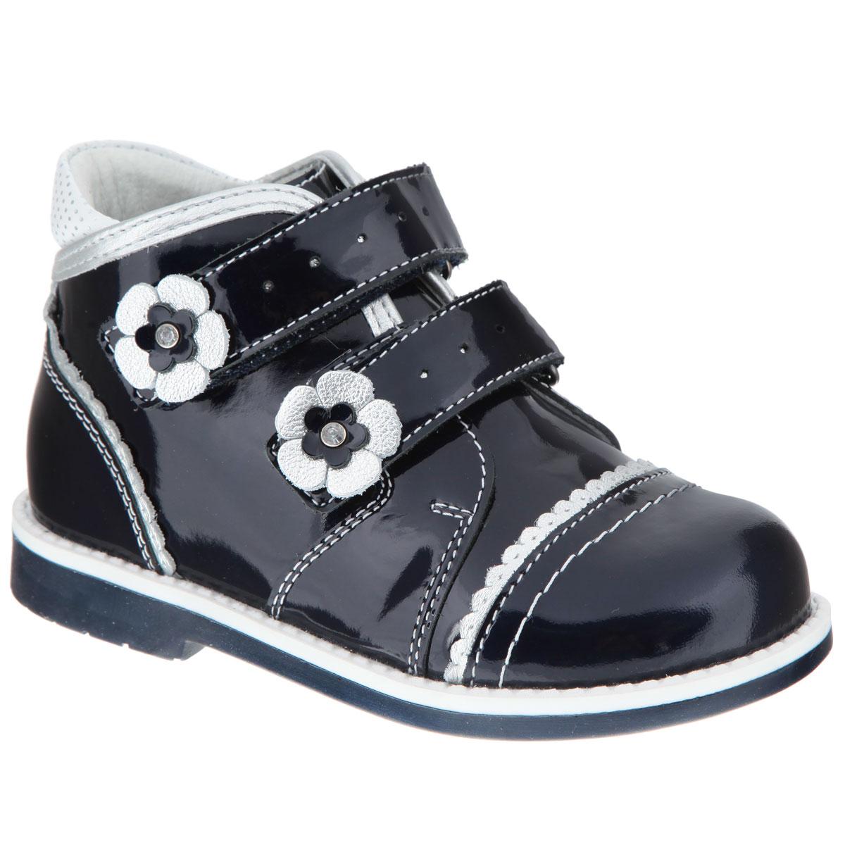 6/7-801361501Очаровательные ботинки от Elegami приведут в восторг вашу юную модницу! Модель выполнена из натуральной лакированной кожи и оформлена волнообразной окантовкой, на заднике - вставкой контрастного цвета с узором в мелкий горошек. Два ремешка на застежках-липучках, дополненные перфорацией и аппликациями в виде цветочков, прочно зафиксируют модель на ноге. Стелька из натуральной кожи с супинатором гарантирует правильное положение ноги ребенка при ходьбе, предотвращает плоскостопие. Низкий каблук и подошва с рифлением обеспечивают идеальное сцепление с любыми поверхностями. Удобные ботинки - необходимая вещь в гардеробе каждого ребенка.