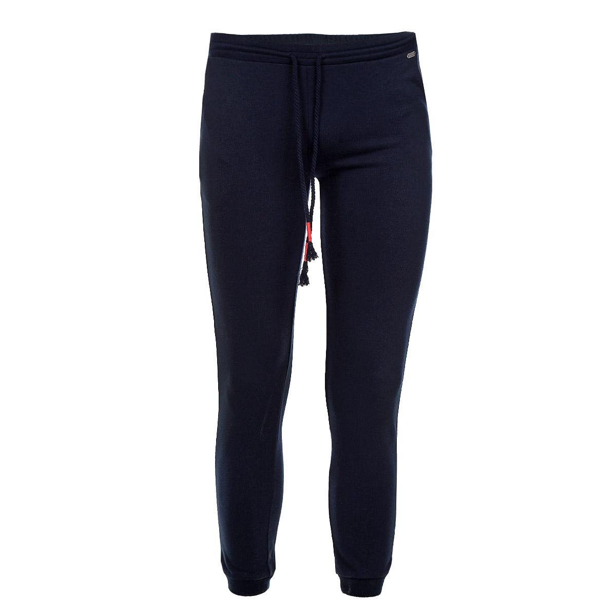 Брюки спортивные женские. Pk-115/592-5372Pk-115/592-5372Спортивные женские брюки Sela идеально подойдут для отдыха и прогулок. Изготовленные из полиэстера и хлопка, они мягкие и приятные на ощупь, не сковывают движения и позволяют коже дышать, обеспечивая наибольший комфорт. Брюки на талии имеют широкую трикотажную резинку, регулируемую шнурком. По бокам модель дополнена двумя втачными карманами. Брючины дополнены широкими манжетами. Современный дизайн и актуальная расцветка делают эти брюки модным и стильным предметом гардероба. Отличный выбор для занятий спортом и активного отдыха!