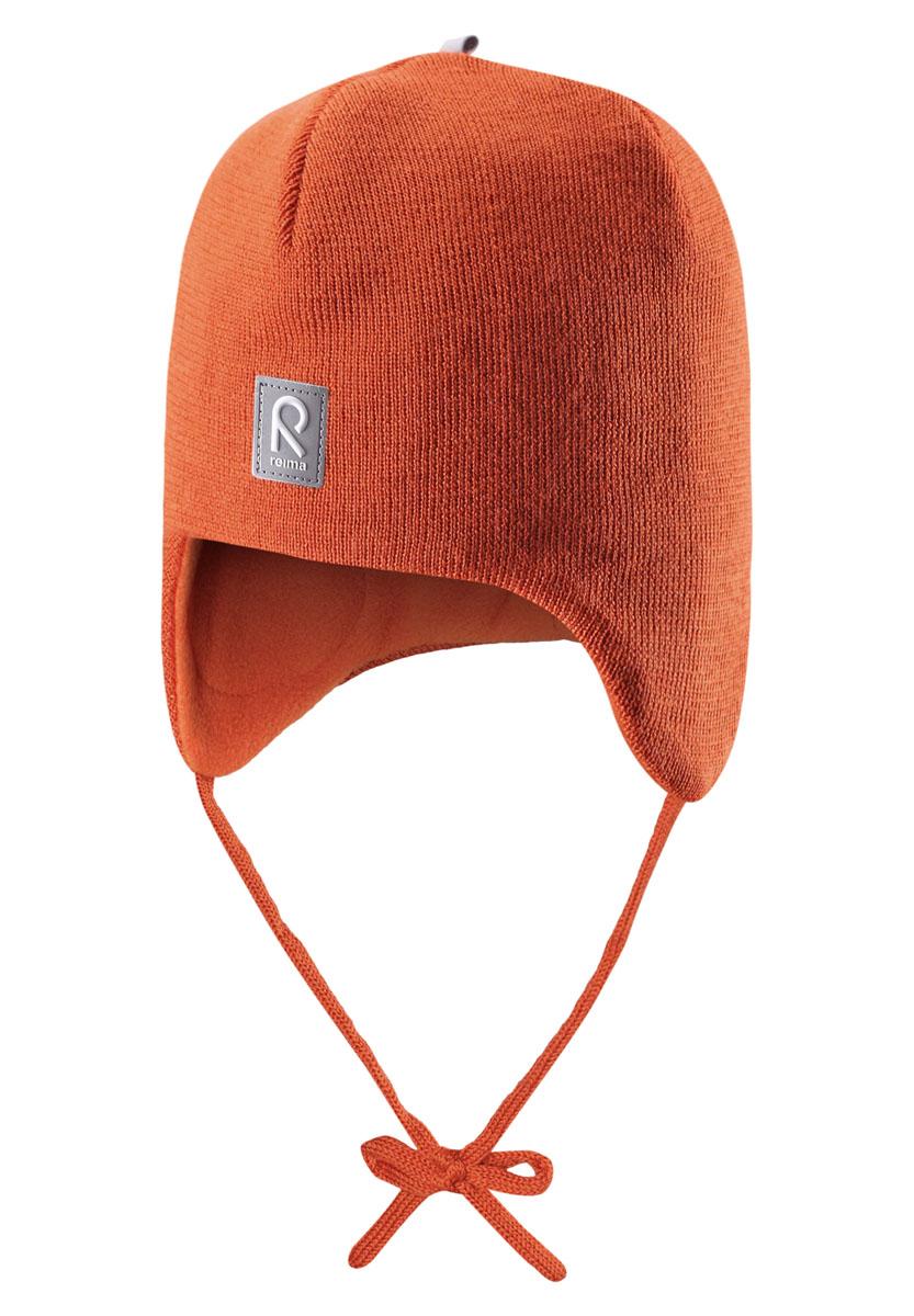 Шапка детская518316_2840Теплая детская шапка-бини Reima Auva идеально подойдет для прогулок в прохладное время года. Изделие, изготовленное из 100% шерсти на мягкой флисовой подкладке, максимально сохраняет тепло. Благодаря эластичной вязке, шапка плотно прилегает к голове ребенка. Шапочка дополнена ветронепроницаемыми вставками в области ушей, которые защищают маленькие ушки от холодного ветра, а также завязками, фиксирующимися под подбородком. Спереди предусмотрена небольшая светоотражающая нашивка с логотипом бренда, которая не оставит вашего ребенка незамеченным в темное время суток. Современный дизайн и расцветка делают эту шапку модным и стильным предметом детского гардероба. В ней ребенку будет тепло, уютно и комфортно. Уважаемые клиенты! Размер, доступный для заказа, является обхватом головы.