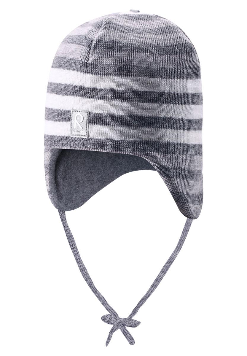 Шапка-бини детская Auva. 518316518316_4830Теплая детская шапка-бини Reima Auva идеально подойдет для прогулок в прохладное время года. Изделие, изготовленное из 100% шерсти на мягкой флисовой подкладке, максимально сохраняет тепло. Благодаря эластичной вязке, шапка плотно прилегает к голове ребенка. Шапочка дополнена ветронепроницаемыми вставками в области ушей, которые защищают маленькие ушки от холодного ветра, а также завязками, фиксирующимися под подбородком. Модель оформлена вязаными полосками. Спереди предусмотрена небольшая светоотражающая нашивка с логотипом бренда, которая не оставит вашего ребенка незамеченным в темное время суток. Современный дизайн и расцветка делают эту шапку модным и стильным предметом детского гардероба. В ней ребенку будет тепло, уютно и комфортно. Уважаемые клиенты! Размер, доступный для заказа, является обхватом головы.