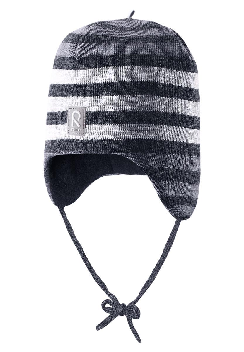 Шапка детская518316_4830Теплая детская шапка-бини Reima Auva идеально подойдет для прогулок в прохладное время года. Изделие, изготовленное из 100% шерсти на мягкой флисовой подкладке, максимально сохраняет тепло. Благодаря эластичной вязке, шапка плотно прилегает к голове ребенка. Шапочка дополнена ветронепроницаемыми вставками в области ушей, которые защищают маленькие ушки от холодного ветра, а также завязками, фиксирующимися под подбородком. Модель оформлена вязаными полосками. Спереди предусмотрена небольшая светоотражающая нашивка с логотипом бренда, которая не оставит вашего ребенка незамеченным в темное время суток. Современный дизайн и расцветка делают эту шапку модным и стильным предметом детского гардероба. В ней ребенку будет тепло, уютно и комфортно. Уважаемые клиенты! Размер, доступный для заказа, является обхватом головы.