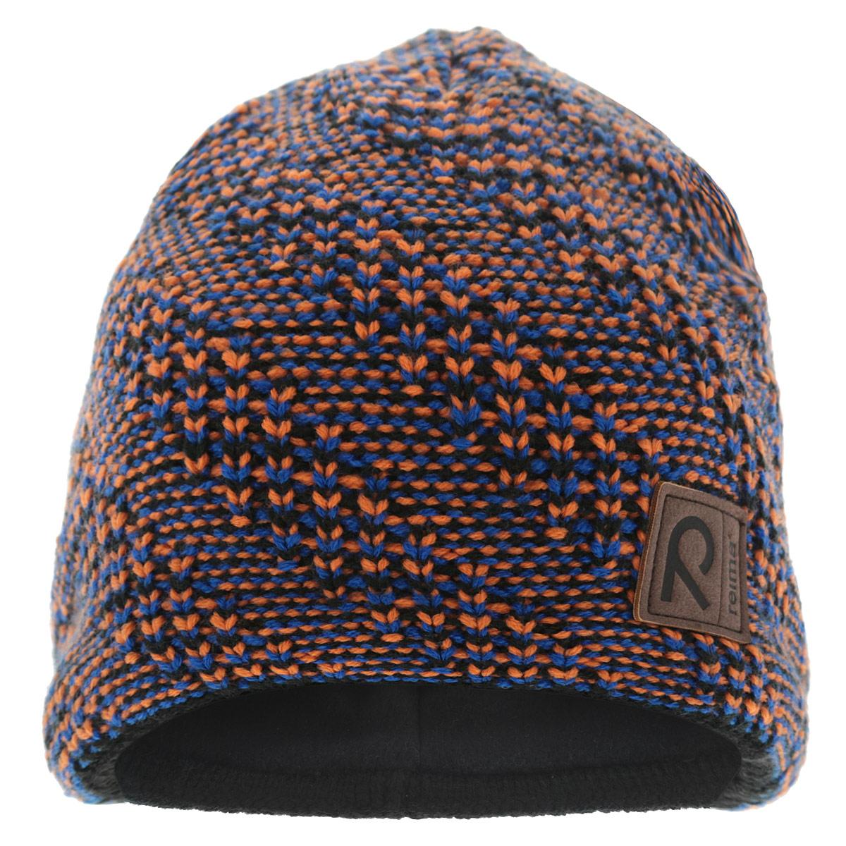 538012-6590Уютная теплая детская шапка Reima идеально подойдет для прогулок в холодное время года. Шапочка мелкой вязки с ветрозащитными вставками в области ушей, выполненная из акриловой пряжи, максимально сохраняет тепло, она мягкая и идеально прилегает к голове. Шапочка хорошо тянется и устойчива к сминанию. Мягкая подкладка выполнена из полиэстера, поэтому шапка хорошо сохраняет тепло и не продувается. Такая шапка станет модным и стильным дополнением гардероба вашего малыша. Она поднимет ему настроение даже в самые морозные дни! Уважаемые клиенты! Размер, доступный для заказа, является обхватом головы.