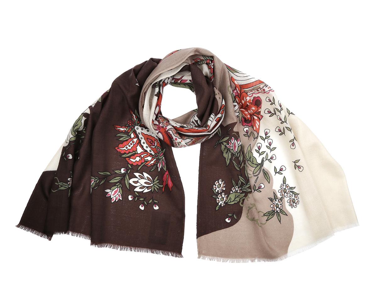 ШарфYNNT0225-58Великолепный женский шарф Leo Ventoni выполнен из шерсти и украшен актуальным узором. Края модели оформлены короткой бахромой. С аксессуаром от Leo Ventoni вы сможете полностью изменить свой образ, экспериментируя со способами его завязывания и вариациями сочетаний с разными нарядами.