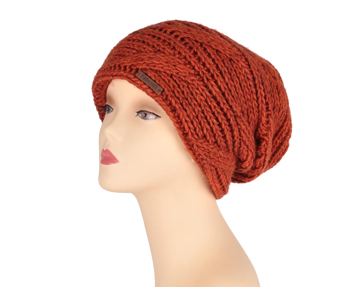 Шапка женская. F2015-22F2015-22-52Стильная женская шапка Fabretti дополнит ваш наряд и не позволит вам замерзнуть в холодное время года. Шапка крупной отворотом выполнена из высококачественной комбинированной пряжи, что позволяет ей великолепно сохранять тепло и обеспечивает высокую эластичность и удобство посадки. Модель оформлена объемным вязаным узором. Такая шапка станет модным и стильным дополнением вашего зимнего гардероба, великолепно подойдет для активного отдыха и занятия спортом. Она согреет вас и позволит подчеркнуть свою индивидуальность!