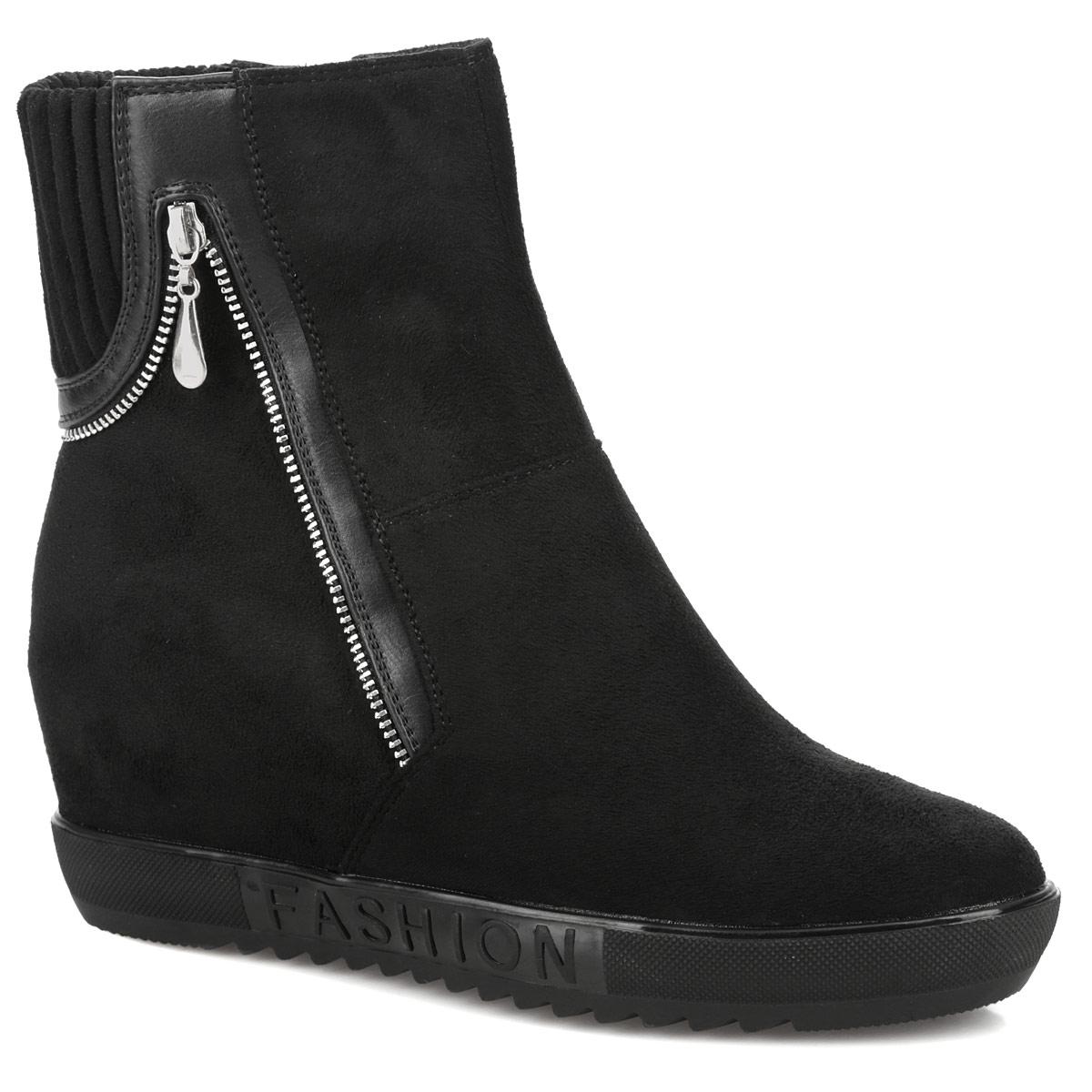 60204-03-1ABУльтрамодные ботильоны от Inario займут достойное место в вашем гардеробе. Модель выполнена из текстиля и оформлена сбоку декоративной молнией, на подошве - надписью Fashion. Ботильоны застегиваются на боковую застежку-молнию. Резинка, расположенная на задней поверхности изделия, гарантирует оптимальную посадку обуви на ноге. Мягкая подкладка и стелька из байки сохраняют тепло, обеспечивая максимальный комфорт при движении. Умеренной высоты скрытая танкетка компенсирована платформой. Подошва с протектором гарантирует идеальное сцепление с любой поверхностью. В таких стильных ботильонах вашим ногам будет комфортно и уютно!