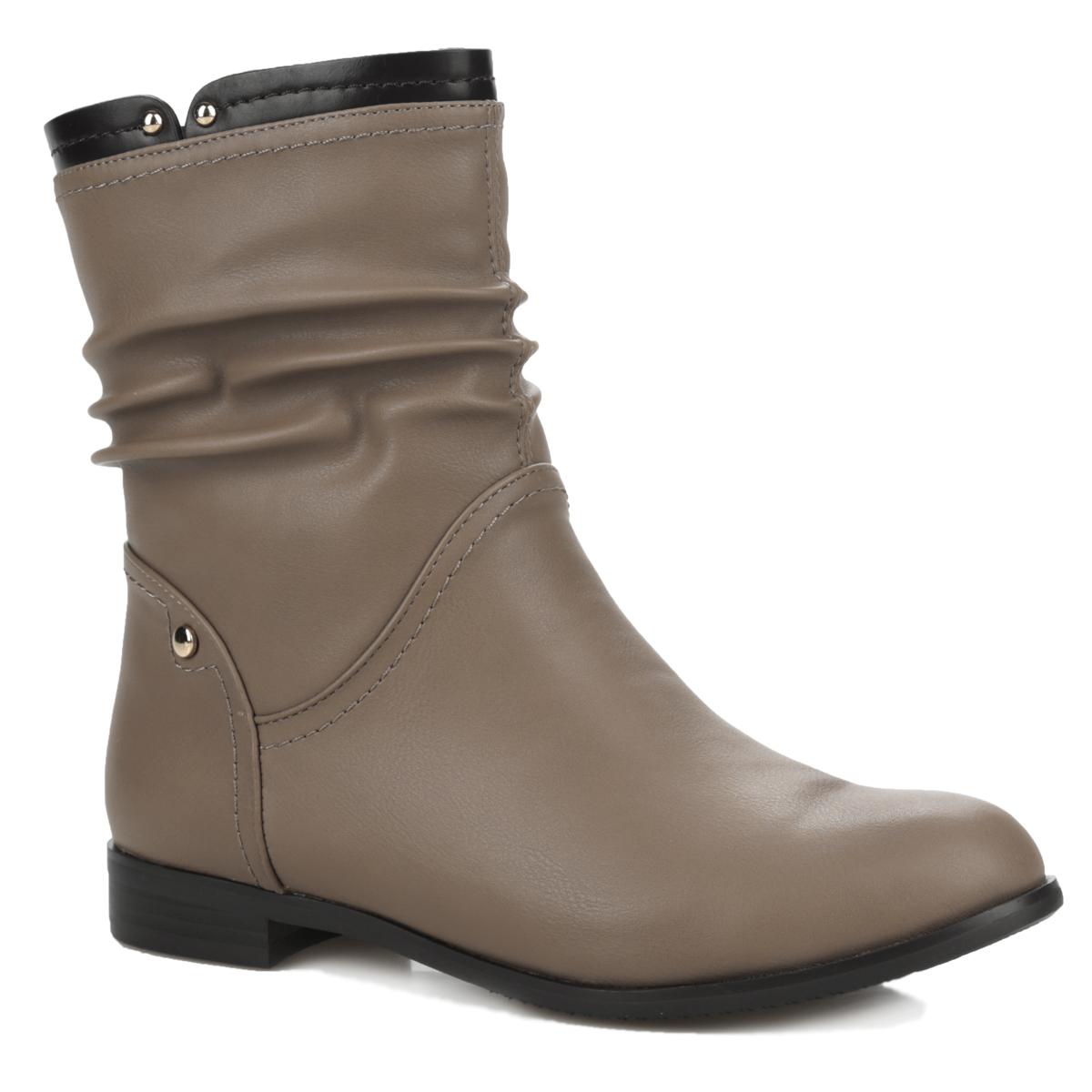 Полусапоги женские. 35-13-01D235-13-01D2Модные полусапоги от Makfly займут достойное место в вашем гардеробе. Модель выполнена из искусственной кожи и оформлена декоративной прострочкой, сбоку - металлической пластиной круглой формы. Верх обуви оформлен небольшими вырезами и металлическими заклепками. Полусапоги застегиваются на удобную застежку-молнию, расположенную сбоку. Подкладка и стелька невероятно комфортны при ходьбе. Невысокий устойчивый каблук удобен при ходьбе. Каблук и подошва дополнены противоскользящим рифлением. Стильные полусапоги покорят вас своим удобством!