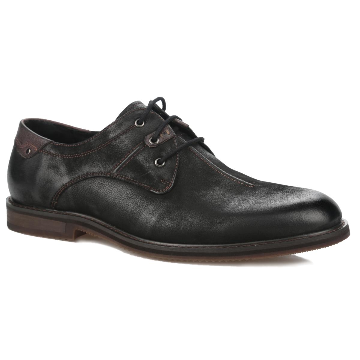Туфли мужские. 109-117-01109-117-01Модные мужские туфли от Dino Ricci займут достойное место среди вашей коллекции обуви. Модель выполнена из натуральной высококачественной кожи и оформлена лаконичной прострочкой, на тыльной поверхности - декоративным отворотом с металлическими заклепками. Шнуровка позволяет прочно зафиксировать обувь на ноге. Стелька из натуральной кожи обеспечивает максимальный комфорт при движении. Перфорация на стельке позволяет вашим ногам дышать. Каблук оформлен вставкой, стилизованной под дерево. Рифленая поверхность подошвы и каблука защищает изделие от скольжения. Стильные туфли прекрасно дополнят ваш деловой образ.
