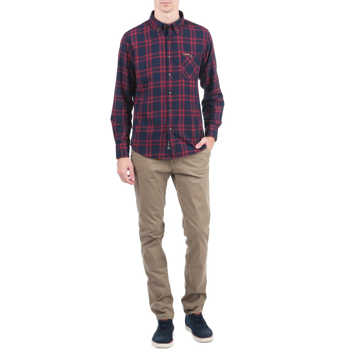 Рубашка10153057_388Стильная рубашка Broadway с длинными рукавами, отложным воротником и застежкой на пуговицы приятная на ощупь, не сковывает движения, обеспечивая наибольший комфорт. Рубашка, выполненная из хлопка, обладает высокой воздухопроницаемостью и гигроскопичностью, позволяет коже дышать, тем самым обеспечивая наибольший комфорт при носке даже самым жарким летом. Модель оформлена ярким клетчатым принтом и накладным карман, застегивающимся на пуговицу. Эта модная и удобная рубашка послужит замечательным дополнением к вашему гардеробу.