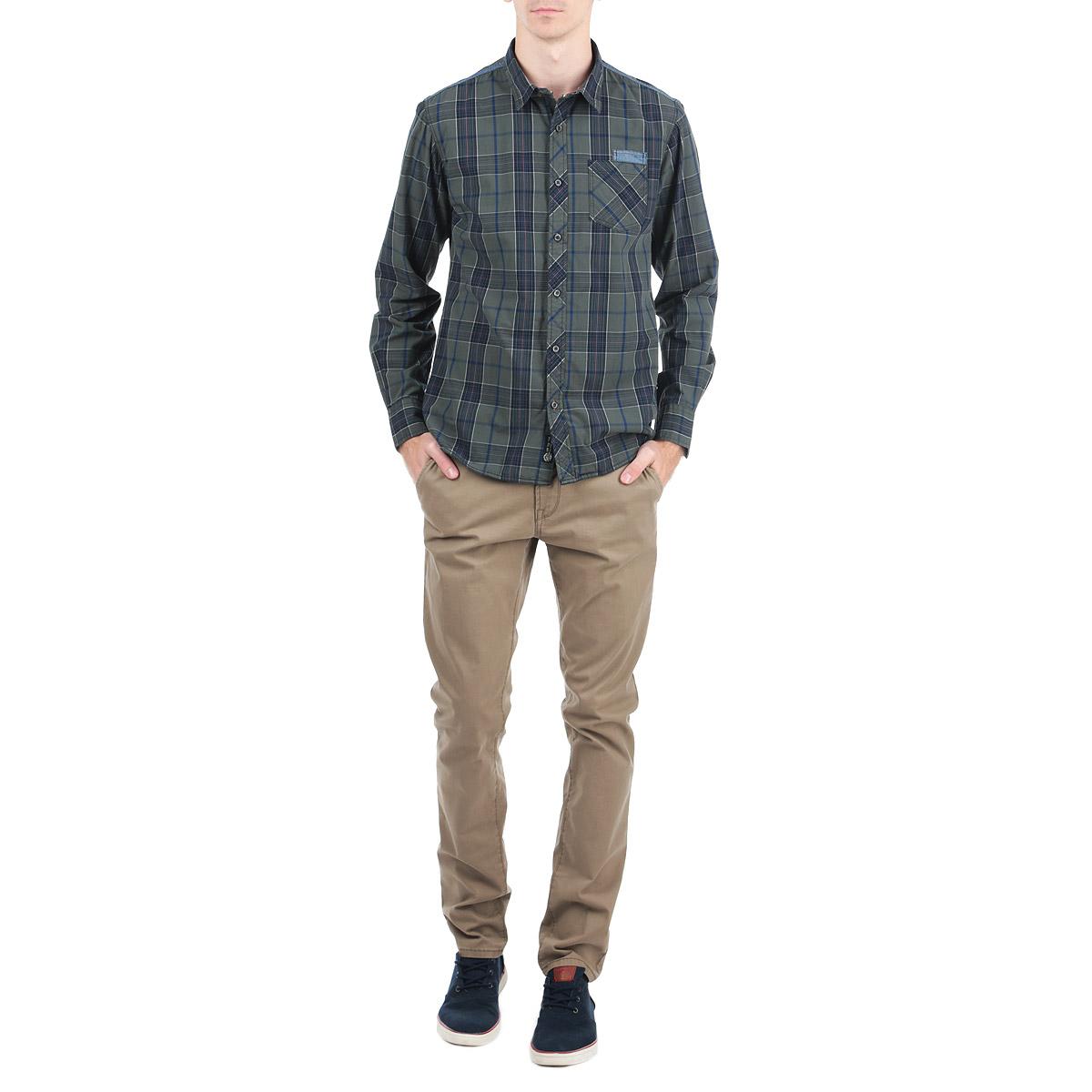 Рубашка10153052_557Стильная рубашка Broadway с длинными рукавами, отложным воротником и застежкой на пуговицы приятная на ощупь, не сковывает движения, обеспечивая наибольший комфорт.Рубашка, выполненная из хлопка, обладает высокой воздухопроницаемостью и гигроскопичностью, позволяет коже дышать, тем самым обеспечивая наибольший комфорт при носке даже самым жарким летом. Модель оформлена ярким клетчатым принтом, накладным карманом слева и потайным кармашком. Эта модная и удобная рубашка послужит замечательным дополнением к вашему гардеробу.