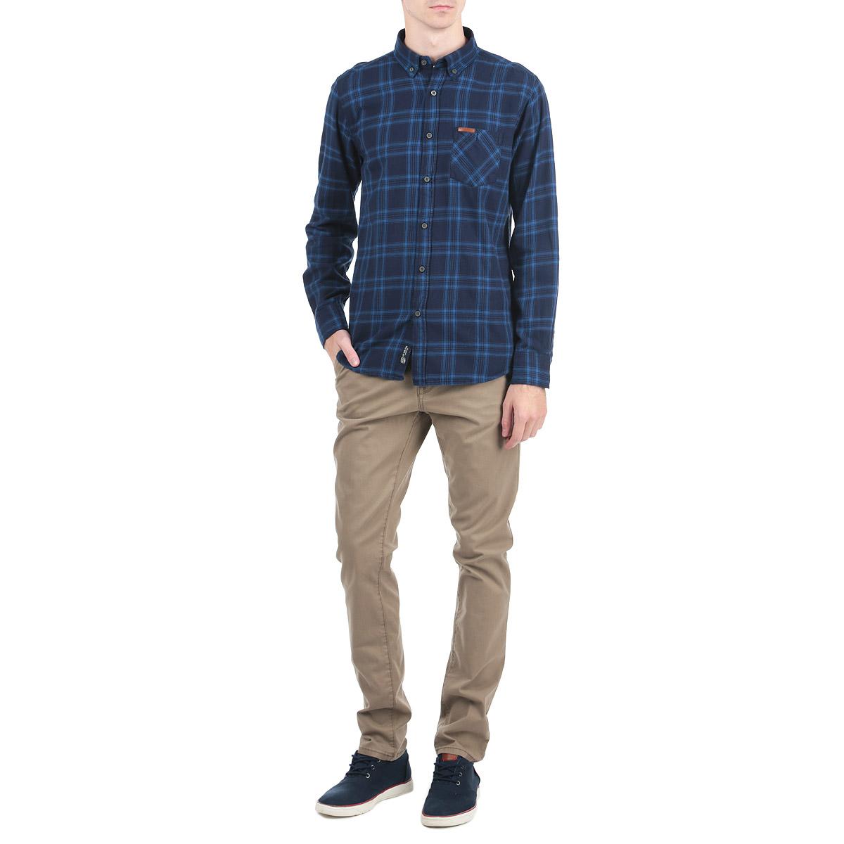 Рубашка мужская. 1015305710153057_388Стильная рубашка Broadway с длинными рукавами, отложным воротником и застежкой на пуговицы приятная на ощупь, не сковывает движения, обеспечивая наибольший комфорт. Рубашка, выполненная из хлопка, обладает высокой воздухопроницаемостью и гигроскопичностью, позволяет коже дышать, тем самым обеспечивая наибольший комфорт при носке даже самым жарким летом. Модель оформлена ярким клетчатым принтом и накладным карман, застегивающимся на пуговицу. Эта модная и удобная рубашка послужит замечательным дополнением к вашему гардеробу.