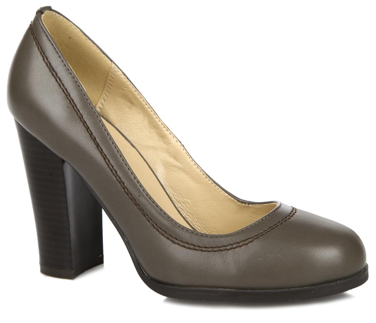 Туфли женские. 60267-01-39K60267-01-39KЭлегантные женские туфли от Inario заинтересуют вас своим дизайном. Модель выполнена из искусственной кожи. По контуру туфли декорированы двойной строчкой. Закругленный носок добавит женственности в ваш образ. Высокий каблук, стилизованный под дерево, устойчив. Подкладка и стелька - из искусственной кожи, обеспечивают максимальный комфорт при движении. Резиновая подошва с рифленым протектором не скользит. Изысканные туфли добавят шика в модный образ и подчеркнут ваш безупречный вкус.