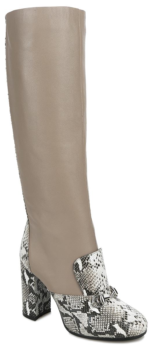 47086Стильные женские сапоги от Vitacci не оставят равнодушной настоящую модницу! Модель изготовлена из натуральной кожи. Внутренняя часть и стелька - из ворсина, защитят ноги от холода и обеспечат комфорт. На мысе и подъеме сапоги дополнены декоративными вставками из кожи с тиснением под рептилию и небольшим декоративным металлическим элементом под серебро. Задняя часть изделия и каблук также дополнены декоративными вставками из кожи с тиснением под рептилию и декоративной металлической молнией. Высокий каблук устойчив. Сапоги застегиваются на застежку-молнию, расположенную на одной из боковых сторон. Подошва из термополиуретана с рельефным протектором обеспечивает отличное сцепление на любой поверхности. Каблук, стилизованный под дерево, устойчив. Модные сапоги покорят вас своим оригинальным дизайном и удобством!