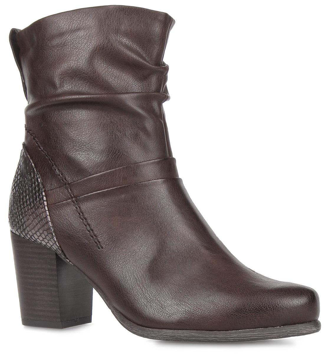 2-2-25387-25-395Модные женские ботинки от Marco Tozzi - идеальный вариант на каждый день. Модель выполнена из искусственной гладкой кожи и декорирована в области задника вставкой с узором, имитирующим змеиную кожу. Подкладка и стелька - из мягкого текстиля, защитят ноги от холода и обеспечат комфорт. Подъем и голенище украшены декоративными складками. К задней части голенища прикреплен ярлычок с металлической кнопкой. Умеренный высоты каблук, стилизованный под дерево, устойчив. Ботинки застегиваются на молнию, расположенную на одной их боковых сторон. Подошва из резины с рельефным протектором обеспечивает отличное сцепление на любой поверхности. В этих ботинках вашим ногам будет комфортно и уютно. Они подчеркнут ваш стиль и индивидуальность.