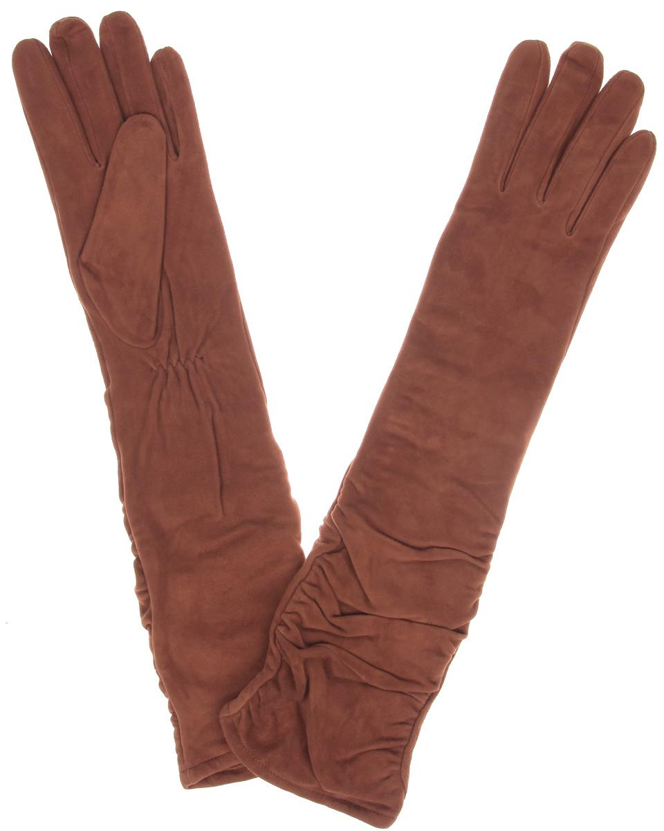 IS02010Элегантные удлиненные женские перчатки Eleganzza станут великолепным дополнением вашего образа и защитят ваши руки от холода и ветра во время прогулок. Перчатки выполнены из натурального нежного велюра и имеют подкладку из шерсти с добавлением акрила, что позволяет им надежно сохранять тепло и обеспечивает высокую гигроскопичность. Перчатки дополнены сборками на запястьях. Удлиненные манжеты подчеркнут изящество ваших рук. Такие перчатки будут оригинальным завершающим штрихом в создании современного модного образа, они подчеркнут ваш изысканный вкус и станут незаменимым и практичным аксессуаром.