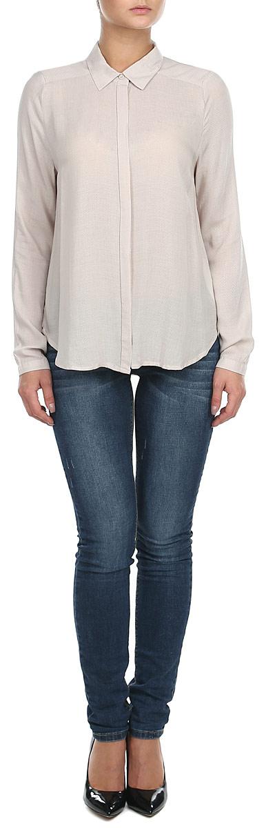 Блузка женская. 1015316910153169 001Воздушная женская блузка Broadway, изготовленная из полупрозрачной вискозы, не сковывает движения, обеспечивая наибольший комфорт. Блузка полуприлегающего силуэта с длинными рукавами, отложным воротничком и полукруглым низом спереди застегивается на пластиковые пуговицы по всей длине. Края рукавов снабжены манжетами на пуговицах. Блузка Broadway - идеальный выбор для создания нежного женственного образа.