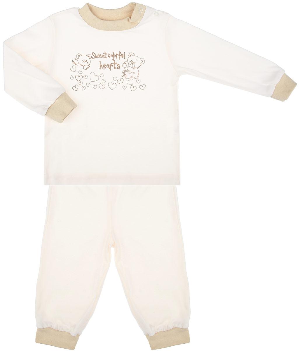 Пижама детская Мишка на экрю. 32873287Детская пижама КотМарКот Мишка на экрю, состоящая из футболки с длинным рукавом и брюк, идеально подойдет вашему ребенку и станет отличным дополнением к его гардеробу. Выполненная из натурального хлопка, она необычайно мягкая и легкая, не сковывает движения, позволяет коже дышать и не раздражает даже самую нежную и чувствительную кожу ребенка. Футболка с длинными рукавами и круглым вырезом горловины имеет застежки-кнопки по плечевому шву, что помогает с легкостью переодеть ребенка. Вырез горловины и манжеты на рукавах дополнены трикотажными эластичными резинками. Модель оформлена нежным принтом с изображением медвежат, а также надписью. Брюки прямого кроя на талии имеют эластичную резинку, благодаря чему они не сдавливают животик ребенка и не сползают. Низ брючин дополнен широкими трикотажными манжетами. В такой пижаме ваш ребенок будет чувствовать себя комфортно и уютно во время сна.