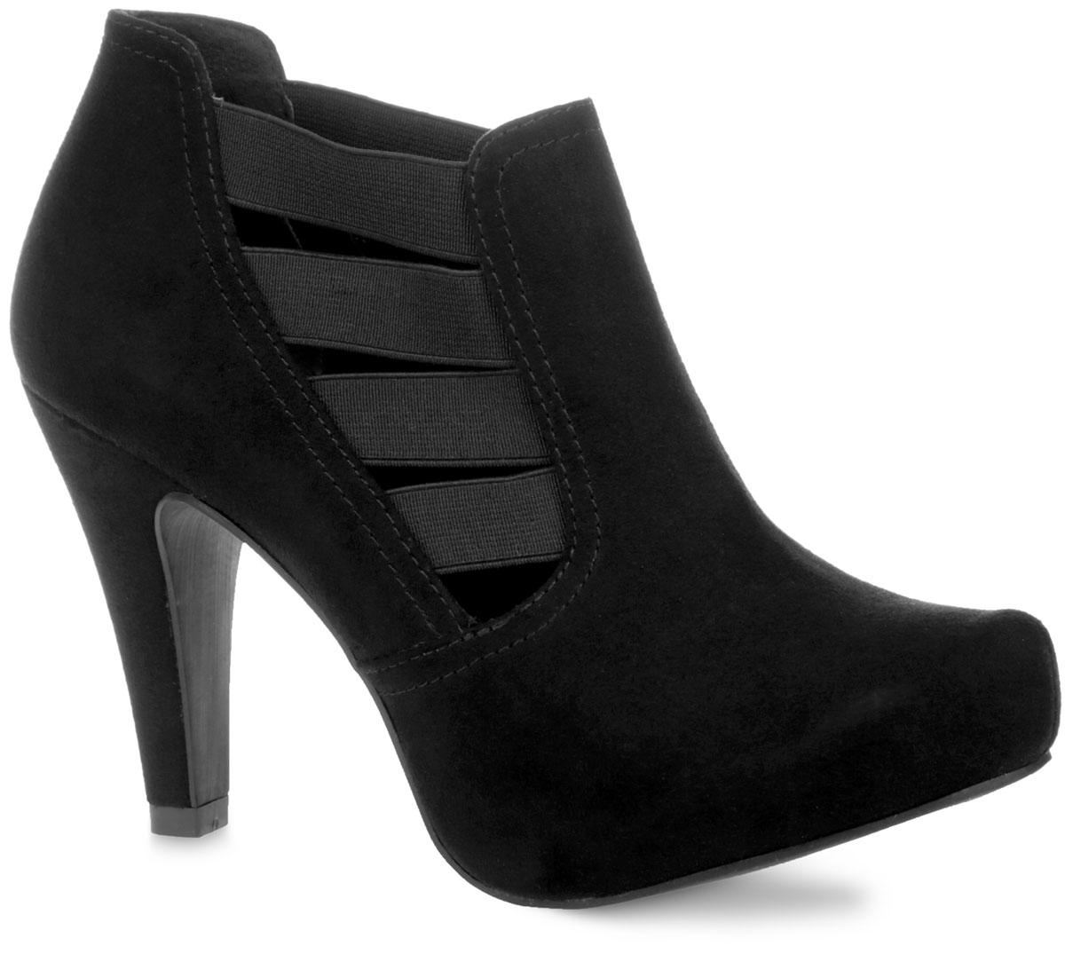 Ботильоны. 2-2-24412-35-0012-2-24412-35-001Элегантные ботильоны от Marco Tozzi займут достойное место в вашем гардеробе. Модель выполнена из искусственного велюра и дополнена по бокам эластичными вставками, которые надежно фиксируют обувь на ноге и регулируют объем. Подкладка - из текстиля, и стелька - из искусственной кожи, обеспечат ногам комфорт и уют. Зауженный носок добавит женственности в ваш образ. Высокий конусовидный каблук компенсирован скрытой платформой. Подошва из резины с рельефным протектором обеспечивает отличное сцепление на любой поверхности. Изысканные ботильоны добавят в ваш образ немного шарма и подчеркнут ваш безупречный вкус.