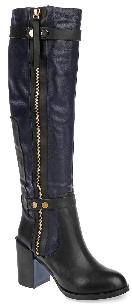 Сапоги женские. 210-193-06 (T)210-193-06 (T)Модные женские сапоги от Dino Ricci займут достойное место в вашем гардеробе. Модель выполнена из натуральной кожи, декорированной фактурными швами по верху и вставками из кожи контрастного цвета. Подкладка и стелька - из мягкого ворсина, защитят ноги от холода и обеспечат комфорт. Верхняя и нижняя часть голенища украшена декоративными ремнями со стильной фурнитурой. Сбоку изделие дополнено декоративной молнией. Сапоги застегиваются на застежку-молнию. Высокий каблук устойчив. Подошва из резины с рельефным протектором обеспечивает отличное сцепление на любой поверхности. В таких сапогах вашим ногам будет уютно и комфортно. Они прекрасно дополнят ваш повседневный образ.