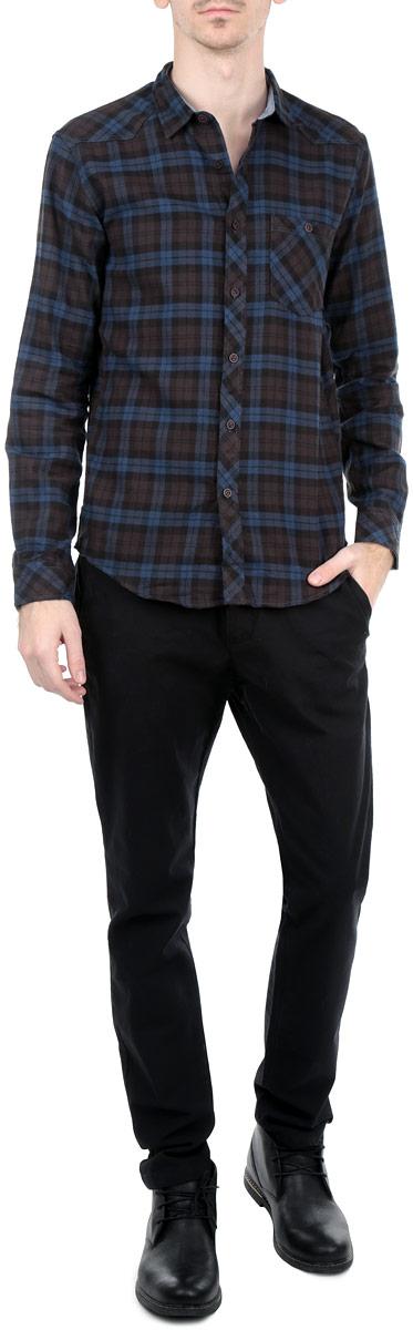 Рубашка мужская. 2030506.00.122030506.00.12_6758Стильная мужская рубашка Tom Tailor, выполненная из натурального хлопка, обладает высокой теплопроводностью, воздухопроницаемостью и гигроскопичностью, позволяет коже дышать, тем самым обеспечивая наибольший комфорт при носке даже самым жарким летом. Модель с длинными рукавами, отложным воротником и полукруглым низом застегивается на пуговицы. Манжеты также застегиваются на пуговицы. Рубашка оформлена клетчатым принтом. На груди расположен накладной карман на пуговице. Такая рубашка будет дарить вам комфорт в течение всего дня и послужит замечательным дополнением к вашему гардеробу.