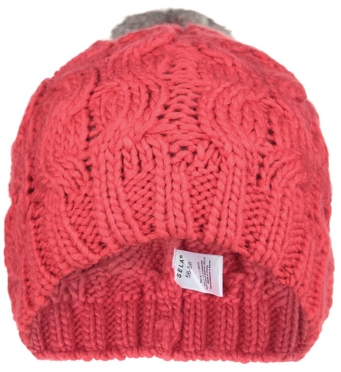 Шапка женская. HAk-141/299-5404HAk-141/299-5404Стильная женская шапка Sela дополнит ваш наряд и не позволит вам замерзнуть в холодное время года. Шапка крупной вязки выполнена из высококачественной акриловой пряжи, что позволяет ей великолепно сохранять тепло и обеспечивает высокую эластичность и удобство посадки. Шапка выполнена оригинальным волнообразным узором и украшена небольшим пушистым помпоном. Такой головной убор, несомненно, понравится и поможет создать актуальный образ.