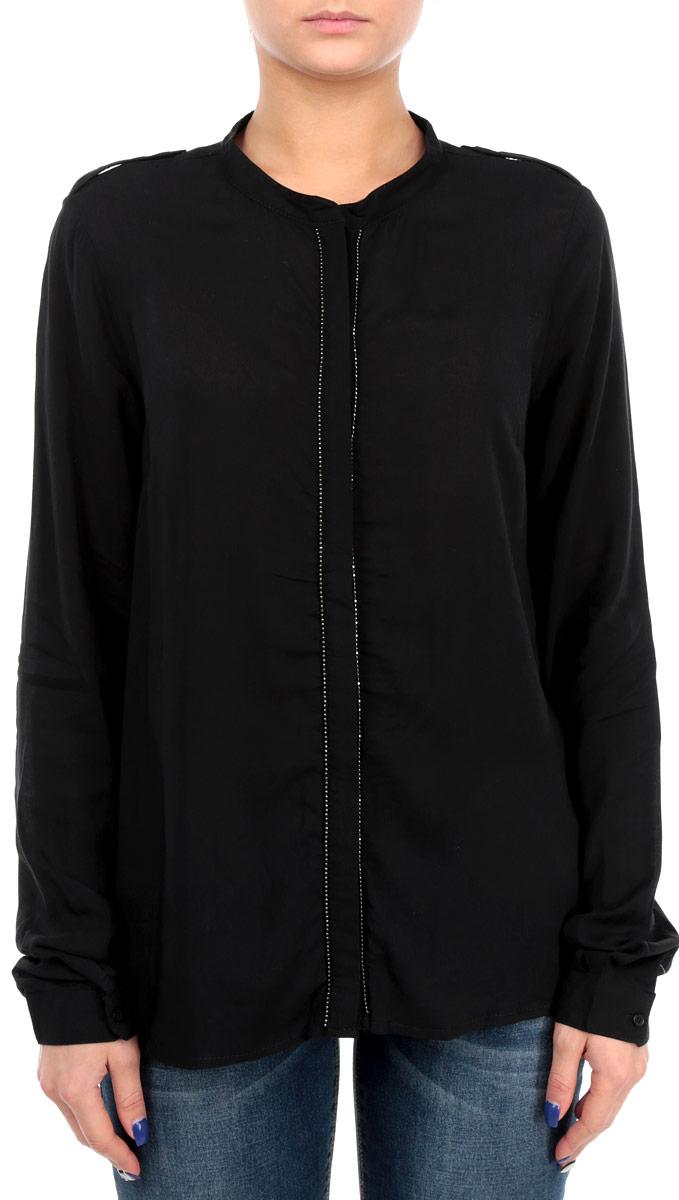60100987 999Стильная женская блуза Broadway, выполненная из высококачественного материала, подчеркнет ваш уникальный стиль. Модная блузка свободного кроя с длинными рукавами и отложным воротником поможет вам создать неповторимый образ. Однотонная блуза великолепно сочетается с любыми нарядами. Модель застегивается на пуговицы, скрытые полочкой. Полка оформлена декоративной нашивкой. Рукава оснащены манжетами на пуговицах. Плечевая зона дополнена хлястиками на пуговицах. Такая блузка будет дарить вам комфорт в течение всего дня и послужит замечательным дополнением к вашему гардеробу.