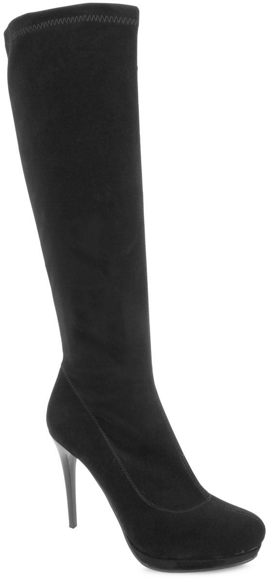 Сапоги женские. L472-B97-1L472-B97-1Элегантные женские сапоги Winzor займут достойное место в вашем гардеробе. Модель выполнена из высококачественного эластичного текстиля, оформленного фактурными швами по верху. Подкладка из текстиля обеспечит комфорт и уют. Стелька из байки защитит ноги от холода. Сапоги застегиваются на застежку-молнию, расположенную на одной из боковых сторон. Зауженный носок добавит женственности в ваш образ. Ультравысокий каблук-шпилька компенсирован платформой. Подошва с рельефным протектором обеспечивает отличное сцепление на любой поверхности. Модные сапоги покорят вас своим оригинальным дизайном и удобством!