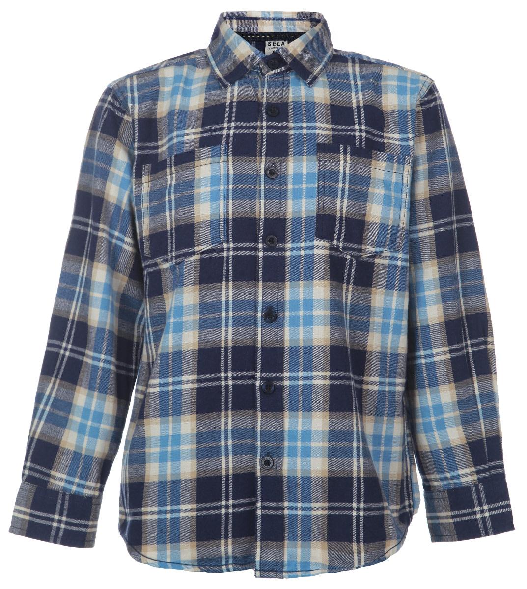 Рубашка для мальчика. H-812/148-5414H-812/148_5414Утепленная рубашка для мальчика Sela с длинными рукавами идеально подойдет вашему ребенку и станет отличным дополнением к детскому гардеробу. Изготовленная из натурального хлопка, она необычайно мягкая и приятная на ощупь, не сковывает движения и позволяет коже дышать, не раздражает даже самую нежную и чувствительную кожу ребенка, обеспечивая ему наибольший комфорт. Рубашка с отложным воротничком застегивается на пуговицы по всей длине. На груди предусмотрены два накладных кармашка. Рукава украшены декоративными заплатами и понизу дополнены широкими манжетами на пуговицах. Оформлена модель принтом в клетку. Современный дизайн и расцветка делают эту рубашку модным и стильным предметом детского гардероба. В ней ваш маленький мужчина всегда будет в центре внимания!