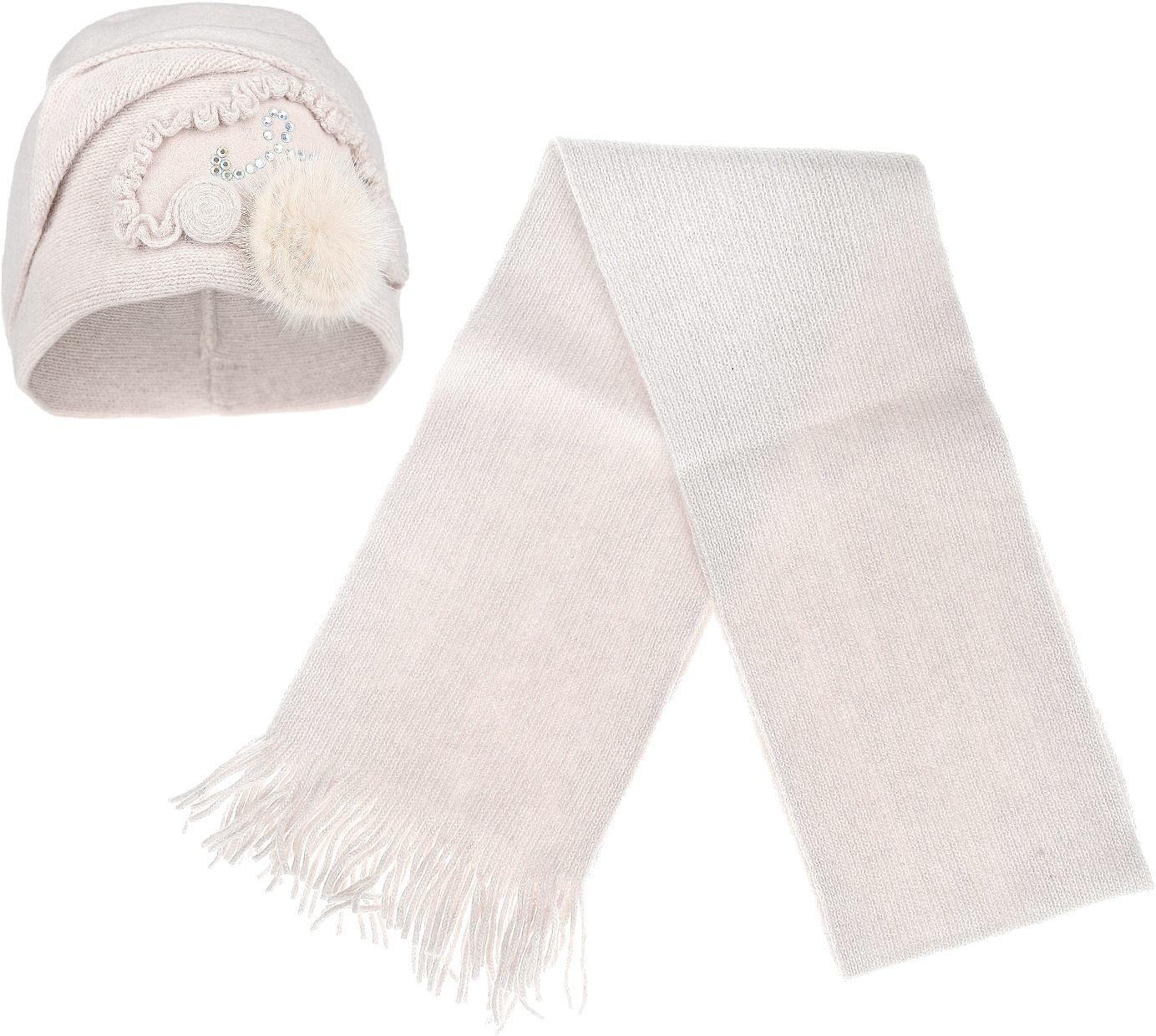 Комплект женский: шапка, шарф. 2013-122013-12-22Потрясающий женский комплект Fabretti, состоящий из шапки и шарфа, отлично дополнит ваш образ в холодную погоду. Комплект выполнен из шерсти с добавлением полиамида. Шапочка с оригинальным отворотом оформлена декоративной нашивкой со стразами и натуральным мехом. Шарфик дополнен аккуратными кисточками. Создайте элегантный образ и подчеркните свою индивидуальность с великолепным комплектом от Fabretti.