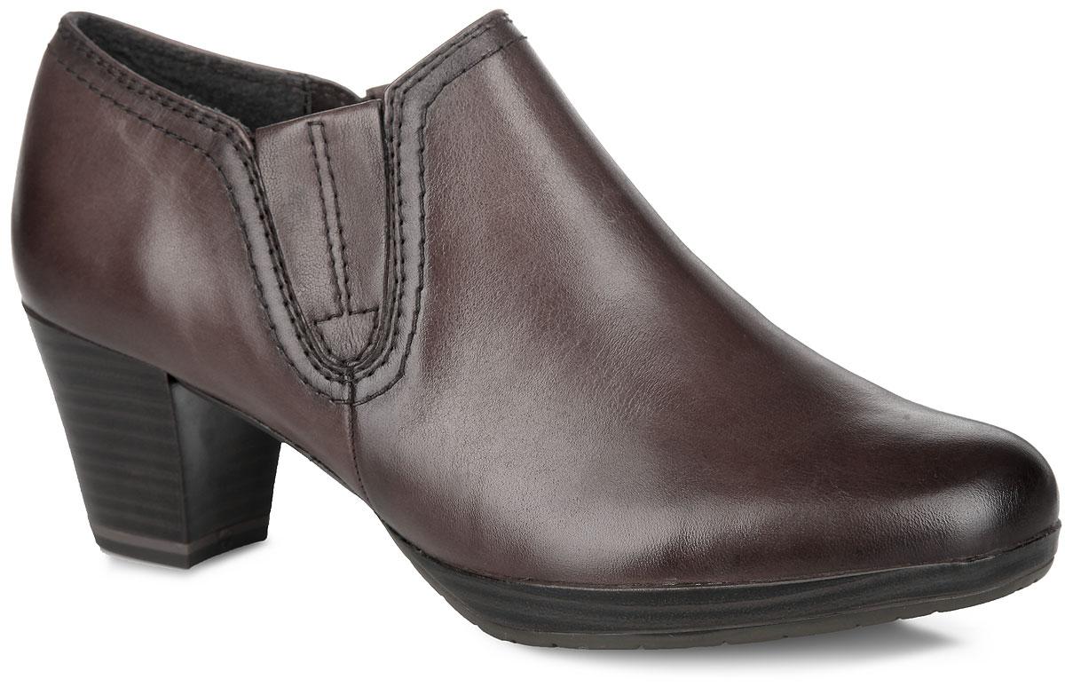Ботильоны. 2-2-24432-252-2-24432-25-002Оригинальные ботильоны от Marco Tozzi - отличный вариант на каждый день. Модель выполнена из натуральной кожи и декорирована по бокам эластичными вставками, которые компенсируют отсутствие застежек. Подкладка из текстиля обеспечивает максимальный комфорт при движении. Стелька из натуральной кожи позволяет ногам дышать. Невысокий каблук, стилизованный под дерево, устойчив. Подошва из резины - с противоскользящим рифлением. В таких ботильонах вашим ногам будет уютно и комфортно! Они прекрасно дополнят ваш повседневный образ.