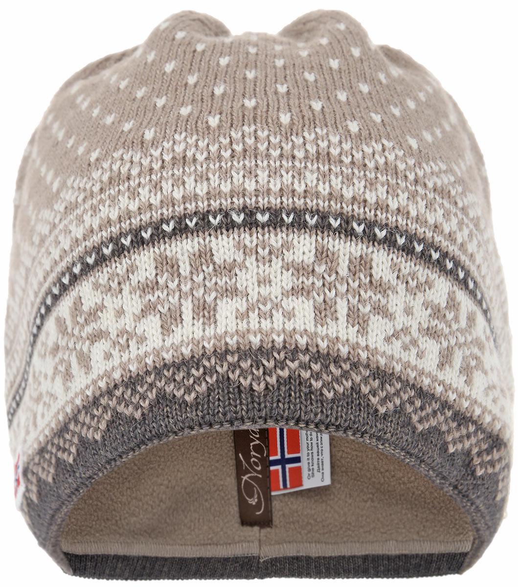 Шапка женская. 43754375Элегантная шапка Noryalli выполнена из альпаки, шерсти, мохера и акрила. Утеплитель - полоска из мягкого флиса. Модель с норвежским орнаментом на макушке дополнена двумя кисточками. Отличный вариант на каждый день.