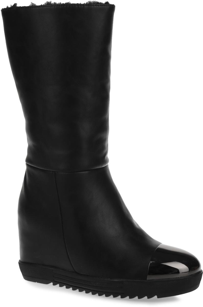 Сапоги для девочки. 558131/10558131/10-03Эффектные сапоги от Keddo придутся по душе любой моднице! Модель изготовлена из искусственной кожи и оформлена на мысе металлической вставкой. Внутренний материал исполнен из искусственного меха и натуральной шерсти. Вшитая резинка, расположенная на голенище, отвечает за оптимальную посадку обуви на ноге. Сапоги застегиваются на боковую застежку-молнию. Стелька из натуральной шерсти сохранит ножки в тепле. Умеренной высоты скрытая танкетка устойчива. Протектор на подошве защищает изделие от скольжения. Стильные сапоги займут достойное место в гардеробе вашего ребенка.