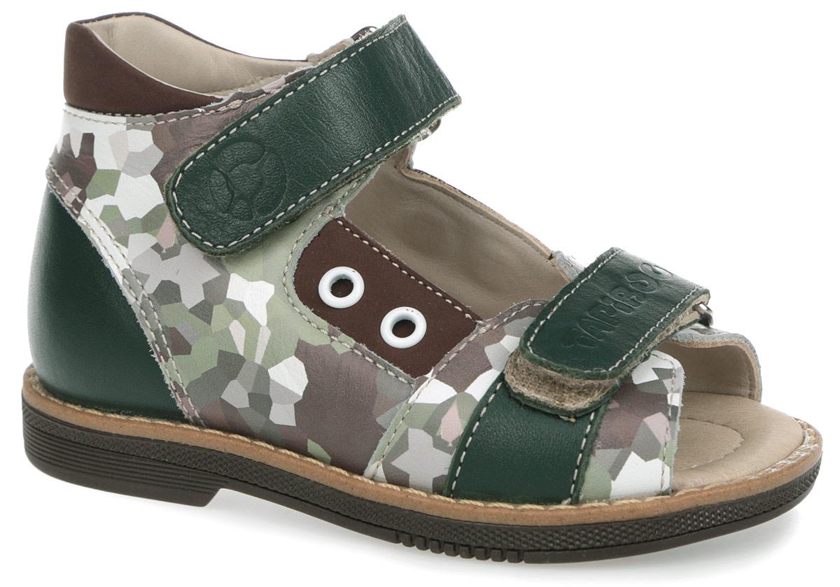 FT-26003.15-OL10O.01Модные сандалии от TapiBoo придутся по душе вам и вашему мальчику! Модель выполнена из натуральной кожи со вставками из натурального нубука. Обувь оформлена принтом в стиле милитари, вдоль ранта - крупной прострочкой, сбоку - декоративными люверсами, на ремешках - тиснениями в виде названия и логотипа бренда, на подошве сзади - названием бренда. Отсутствие швов на подкладке гарантирует дополнительный комфорт и предотвращает натирание. Полужесткий закрытый задник и ремешки на застежках-липучках надежно фиксируют ножку ребенка, не давая ей смещаться из стороны в сторону и назад. Стелька из натуральной кожи дополнена супинатором с перфорацией, который обеспечивает правильное положение ноги ребенка при ходьбе, предотвращает плоскостопие. Ортопедический каблук Томаса укрепляет подошву под средней частью стопы и препятствует заваливанию детской стопы внутрь. Упругая подошва дополнена перекатами, позволяющими повторить естественное движение стопы при ходьбе для правильного распределения...