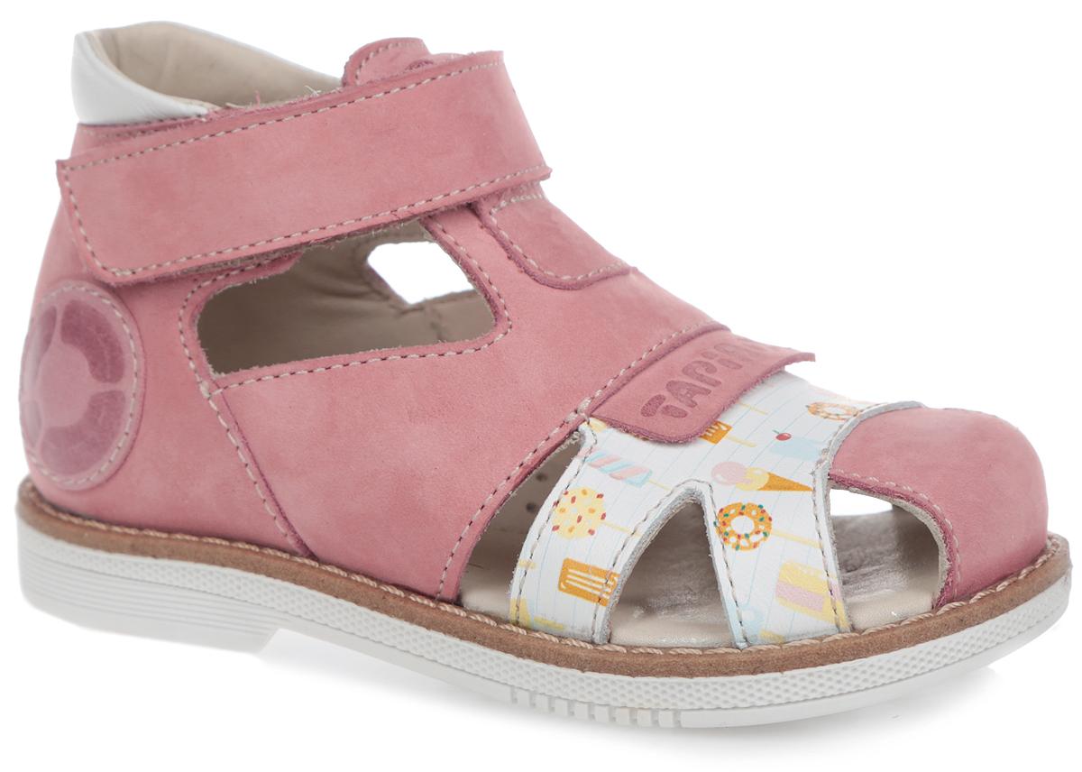 Сандалии для девочки. FT-26002.15-OL05O.01FT-26002.15-OL05O.01Модные сандалии от TapiBoo придутся по душе вам и вашей малышке! Модель выполнена из натурального нубука со вставками из натуральной кожи. Обувь оформлена крупной прострочкой вдоль ранта, на мысе - накладкой с тиснением в виде названия бренда и принтом с изображением различных сладостей, сбоку - аппликацией в виде логотипа бренда, на подошве сзади - названием бренда. Отсутствие швов на подкладке гарантирует дополнительный комфорт и предотвращает натирание. Полужесткий закрытый задник и ремешок на застежке-липучке надежно фиксируют ножку ребенка, не давая ей смещаться из стороны в сторону и назад. Стелька из натуральной кожи дополнена супинатором с перфорацией, который обеспечивает правильное положение ноги ребенка при ходьбе, предотвращает плоскостопие. Ортопедический каблук Томаса укрепляет подошву под средней частью стопы и препятствует заваливанию детской стопы внутрь. Упругая подошва дополнена перекатами, позволяющими повторить естественное движение стопы при ходьбе для...