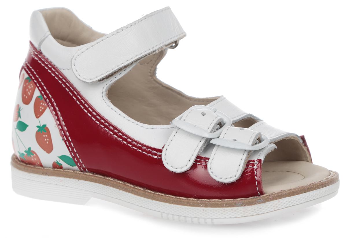 Сандалии для девочки. FT-26001.15-OL04O.01FT-26001.15-OL04O.01Модные сандалии от TapiBoo придутся по душе вам и вашей малышке! Модель выполнена из натуральной кожи со вставками из натурального лака контрастного цвета. Обувь оформлена крупной прострочкой вдоль ранта, на задней поверхности - принтом с изображением землянички, на подошве сзади - названием бренда. Отсутствие швов на подкладке гарантирует дополнительный комфорт и предотвращает натирание. Полужесткий закрытый задник и ремешки (два из них застегиваются на пряжку и один на липучку) надежно фиксируют ножку ребенка, не давая ей смещаться из стороны в сторону и назад. Ярлычок на заднике предназначен для удобства обувания. Стелька из натуральной кожи дополнена супинатором с перфорацией, который обеспечивает правильное положение ноги ребенка при ходьбе, предотвращает плоскостопие. Ортопедический каблук Томаса укрепляет подошву под средней частью стопы и препятствует заваливанию детской стопы внутрь. Упругая подошва дополнена перекатами, позволяющими повторить естественное движение стопы...