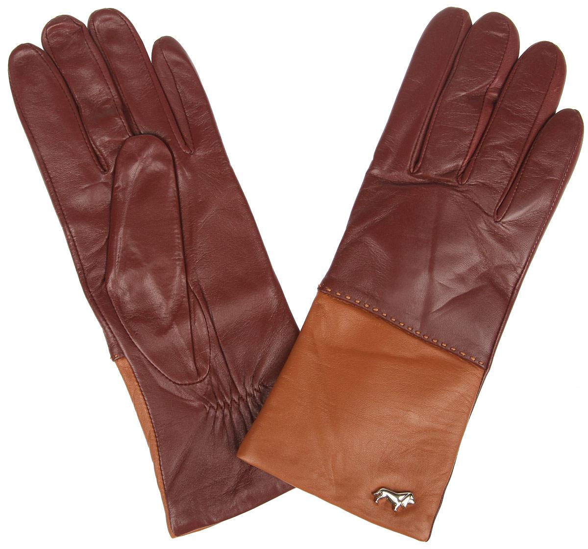 ПерчаткиLB-7777Женские перчатки Labbra не только защитят ваши руки от холода, но и станут стильным украшением. Перчатки выполнены из натуральной кожи ягненка. Они мягкие, максимально сохраняют тепло, идеально сидят на руке. Подкладка изделия изготовлена из шерсти с добавлением акрила. Лицевая сторона изделия дополнена декоративным элементом в виде логотипа бренда. На запястье модель присборена на небольшие эластичные резинки. Перчатки станут завершающим элементом вашего неповторимого стиля и подчеркнут вашу индивидуальность.