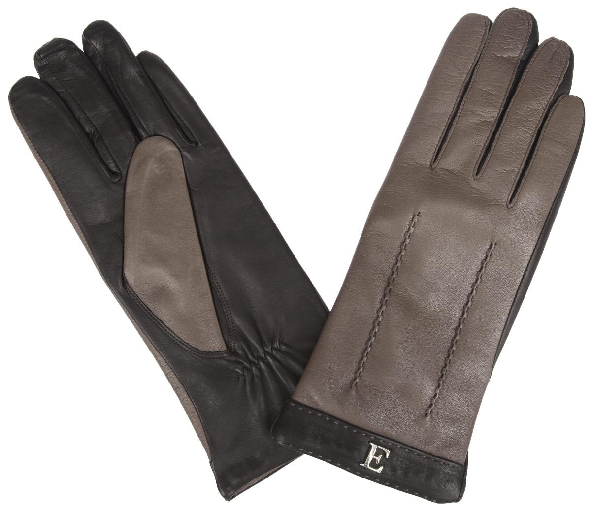 ПерчаткиHP697Стильные женские перчатки Eleganzza не только защитят ваши руки от холода, но и станут великолепным украшением. Перчатки выполнены из натуральной кожи на подкладке из 100% шерсти. На тыльной стороне манжет имеются небольшие сборки резинкой для того, чтобы перчатки лучше сидели. С внешней стороны манжеты украшены контрастными вставками с небольшими декоративными элементами и оригинальной прострочкой. В настоящее время перчатки являются неотъемлемой принадлежностью одежды, вместе с этим аксессуаром вы обретаете женственность и элегантность. Перчатки станут завершающим и подчеркивающим элементом вашего стиля и неповторимости.