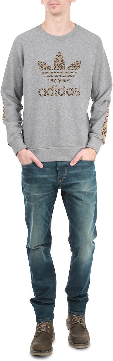 Свитшот мужской Trefoil CrewS27483Стильный мужской свитшот Adidas Trefoil Crew, изготовленный из высококачественного хлопка, мягкий и приятный на ощупь, не сковывает движений и обеспечивает наибольший комфорт. Модель с круглым вырезом горловины и длинными рукавами-реглан оформлена логотипом Adidas и имеет декоративные вставки на локтях. Манжеты рукавов и низ свитшота дополнены резинками. Этот свитшот - настоящее воплощение комфорта, он послужит отличным дополнением к вашему гардеробу. В нем вы будете чувствовать себя уютно в прохладное время года.