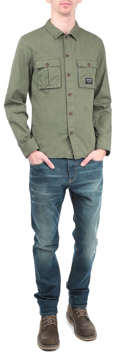 Рубашка мужская. 2030955.00.122030955.00.12_7512Стильная мужская рубашка Tom Tailor Denim, выполненная из высококачественного хлопкового материала, приятная на ощупь, не сковывает движения, обеспечивая наибольший комфорт. Модель с отложным воротником и длинными рукавами застегивается на пластиковые пуговицы по всей длине. Манжеты изделия застегиваются на пуговицы. Спереди модель дополнена двумя нашивными карманами с клапанами на пуговицах. Эта модная и удобная рубашка послужит замечательным дополнением к вашему гардеробу.