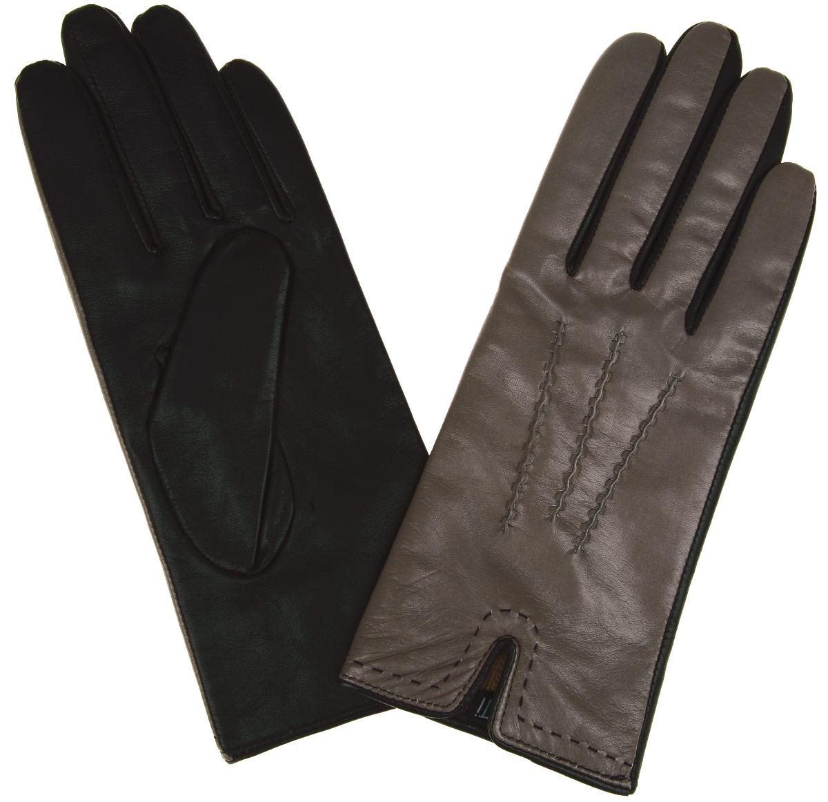 Перчатки2.27-10Элегантные женские перчатки Fabretti станут великолепным дополнением вашего образа и защитят ваши руки от холода и ветра во время прогулок. Перчатки выполнены из эфиопской перчаточной кожи ягненка на подкладке из шерсти с добавлением кашемира, что позволяет им надежно сохранять тепло. Манжеты с внешней стороны дополнены разрезами. Модель оформлена декоративной прострочкой. Такие перчатки будут оригинальным завершающим штрихом в создании современного модного образа, они подчеркнут ваш изысканный вкус и станут незаменимым и практичным аксессуаром.