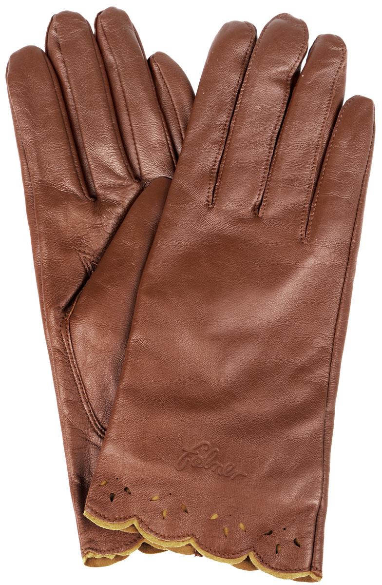 Перчатки женские. L-035L-035Стильные женские перчатки Falner не только защитят ваши руки от холода, но и станут великолепным украшением. Модель изготовлена из чрезвычайно мягкой и приятной на ощупь натуральной кожи, а их подкладка - из шерсти с добавлением акрила. На лицевой стороне изделие оформлено тиснением в виде названия бренда. Фигурные манжеты дополнены небольшими разрезами с тыльной стороны и украшены ажурными рисунками. Перчатки являются неотъемлемой принадлежностью одежды, вместе с этим аксессуаром вы обретаете женственность и элегантность. Они станут завершающим и подчеркивающим элементом вашего неповторимого стиля и индивидуальности.