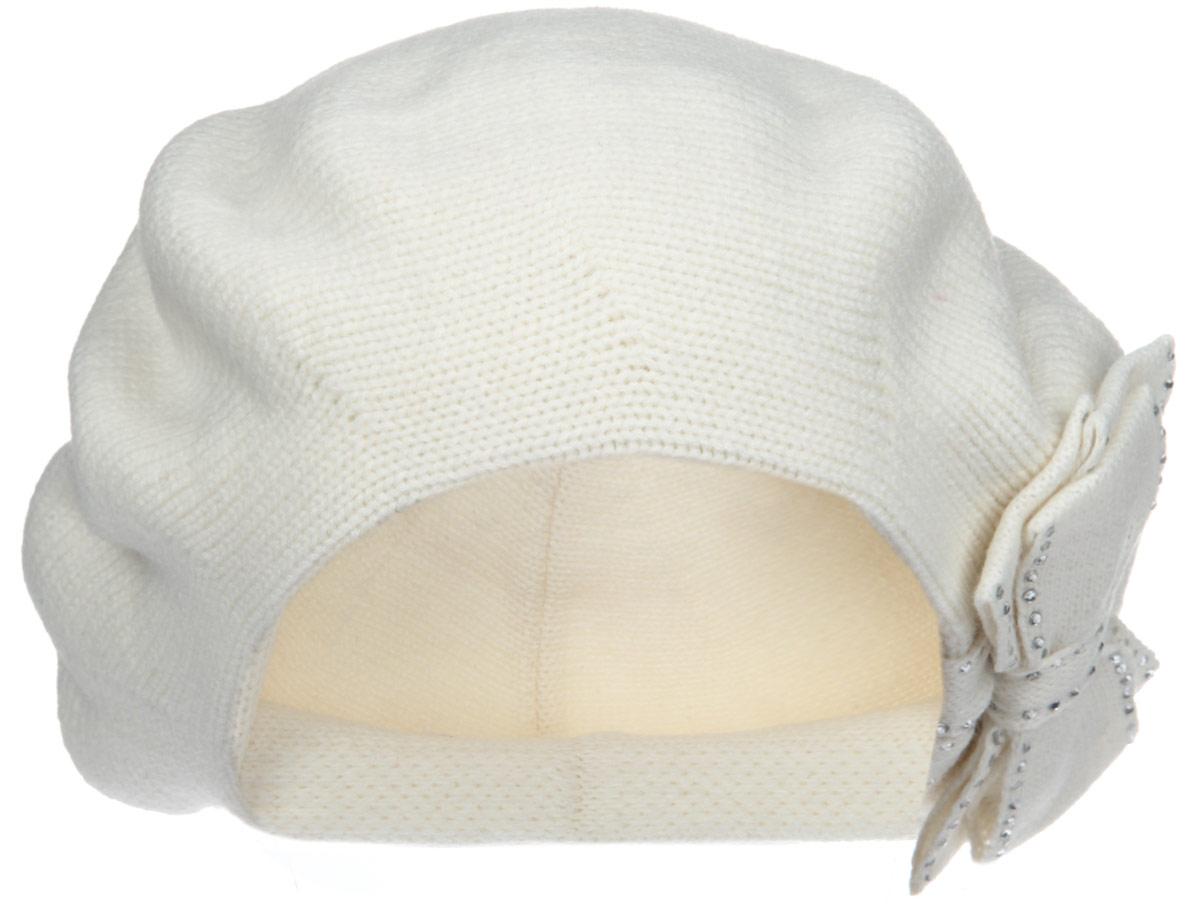Берет1-012-002Элегантный женский берет Flioraj отлично дополнит ваш образ в холодную погоду. Берет выполнен из высококачественной комбинированной пряжи и оснащен вязаной подкладкой, что позволяет ему максимально сохранять тепло и обеспечивает удобную посадку. Берет оформлен декоративным вязаным бантом и украшен сверкающими стразами. Такая модель комфортна и приятна на ощупь, она великолепно подчеркнет ваш вкус и подойдет к любому наряду. Такой берет станет отличным дополнением к вашему осеннему или зимнему гардеробу, в нем вам будет уютно и тепло! Уважаемые клиенты! Размер, доступный для заказа, является обхватом головы.