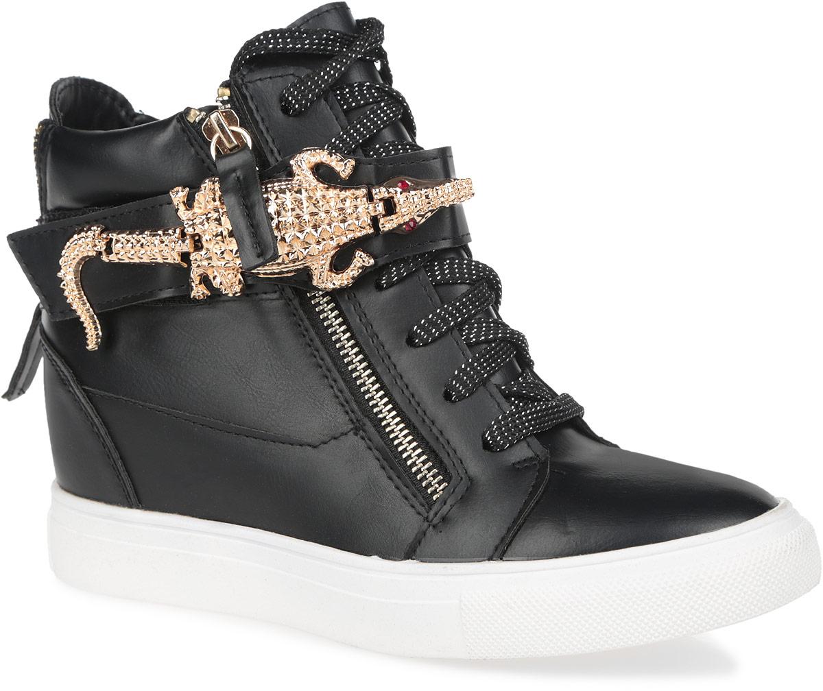 Сникерсы женские. 5128-225128-22/BLACKОригинальные женские сникерсы Burlesque заинтересуют вас своим дизайном. Модель выполнена из искусственной кожи. Верх изделия оформлен шнуровкой и ремешком на застежке-липучке, которые надежно зафиксируют обувь на ноге и отрегулируют объем. Ремешок украшен декоративным металлическим элементом в виде аллигатора, инкрустированным стразами. Внутри сникерсы изготовлены из текстиля с верхней отделкой из искусственной кожи. Стелька из ЭВА материала с покрытием из искусственной кожи обеспечит ногам уют и комфорт. Обувь застегивается на две застежки-молнии, расположенные по бокам. Танкетка умеренной высоты - устойчива. Задник дополнен декоративной молнией. Подошва из полимерного термопластичного материала с рельефным протектором обеспечивает отличное сцепление с любой поверхностью. В этих сникерсах вашим ногам будет комфортно и уютно. Они подчеркнут ваш стиль и индивидуальность.