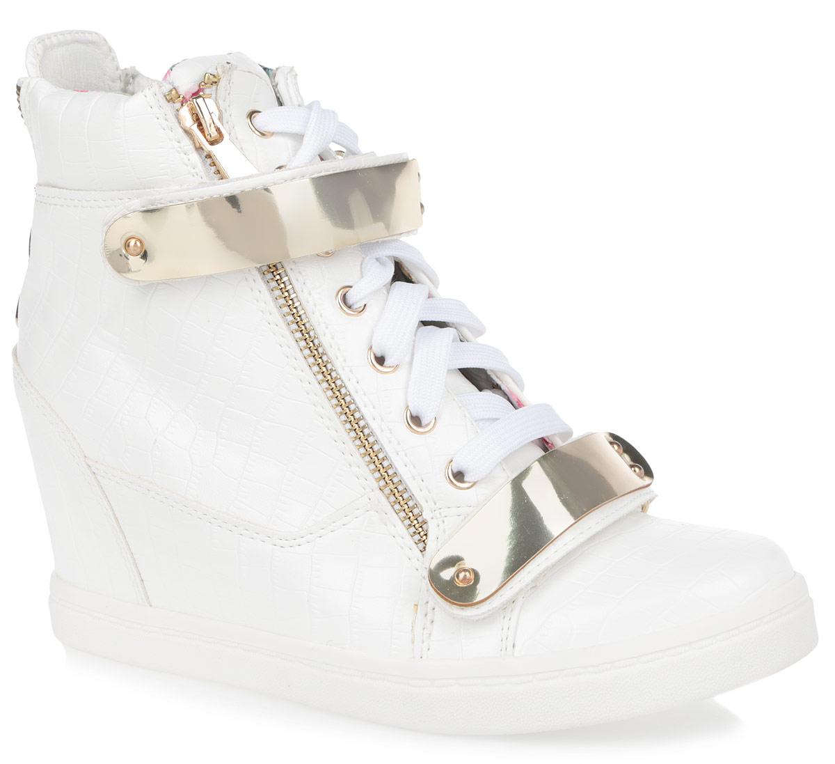 Сникерсы женские. 2021-22021-2/WHITEМодные женские сникерсы Burlesque выполнены из искусственной кожи, оформленной тиснением под рептилию. Верх изделия дополнен шнуровкой, а также двумя ремешками на застежках-липучках, которые надежно зафиксируют обувь на ноге и отрегулируют объем. Подкладка, изготовленная из текстиля с ярким цветочным рисунком, и стелька - из ЭВА материала с покрытием из искусственной кожи, обеспечат ногам уют. Сбоку и на заднике сникерсы украшены декоративной металлической молнией с покрытием под золото, а в области подъема - пластиковыми пластинами с имитацией под металл. Танкетка умеренной высоты - устойчива. Обувь застегивается на застежку-молнию, расположенную с одной из боковых сторон. Подошва из полимерного термопластичного материала с рельефным протектором обеспечивает отличное сцепление с любой поверхностью. В этих сникерсах вашим ногам будет комфортно и уютно. Они подчеркнут ваш стиль и индивидуальность.