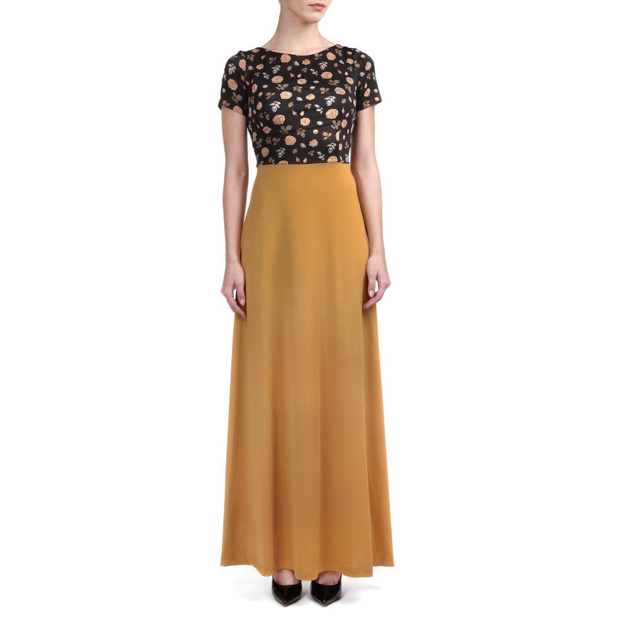 Платье. P21E-23MP21E-23MЭлегантное платье Анна Чапман подарит вам удобство и поможет вам подчеркнуть свой вкус и неповторимый стиль. Изготовленное из полиэстера с добавлением эластана, оно мягкое на ощупь, не раздражает кожу и хорошо вентилируется. Модель макси длины с круглым вырезом горловины и короткими рукавами на спинке имеет V-образный вырез. Отрезная расклешенная юбка однотонная. Лиф выполнен в контрастном цвете и оформлен цветочным принтом. В таком наряде вы, безусловно, привлечете восхищенные взгляды окружающих.