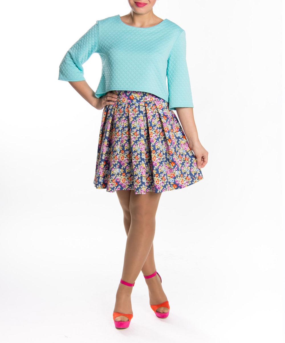 ю0155Нарядная юбка Lautus выполнена мягкого приятного на ощупь материала. Модель застегивается сзади на молнию . Изделие оформлено красочным цветочным принтом. Широкий пояс выгодно подчеркивает талию. Стильная юбка выгодно освежит и разнообразит любой гардероб. Создайте женственный образ и подчеркните свою яркую индивидуальность!